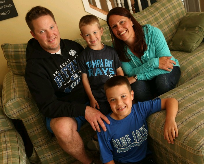 Nurse practitioner Kelly Naab, right, of Clarence, at home with her husband Tim, son Ryder, 4, and son Cooper, 7, front, who has a peanut allergy. (Sharon Cantillon/Buffalo News)