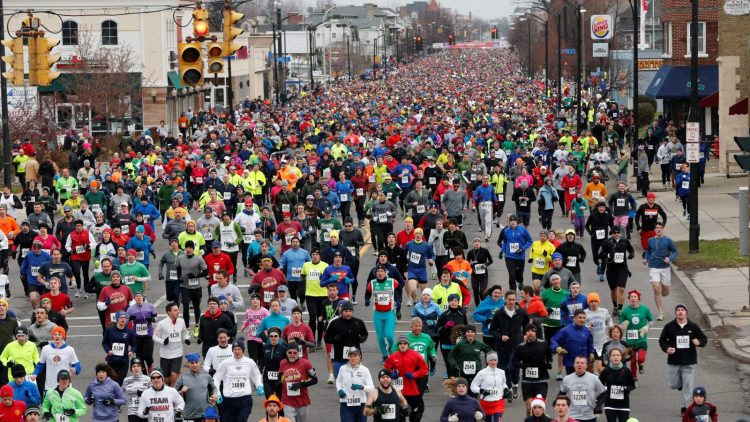 Thousands of runners line Delaware Avenue annually on Thanksgiving Day. The Turkey Trot, a fundraiser for the YMCA, is just one of many things for which Western New Yorkers can be grateful. (Derek Gee/News file photo)