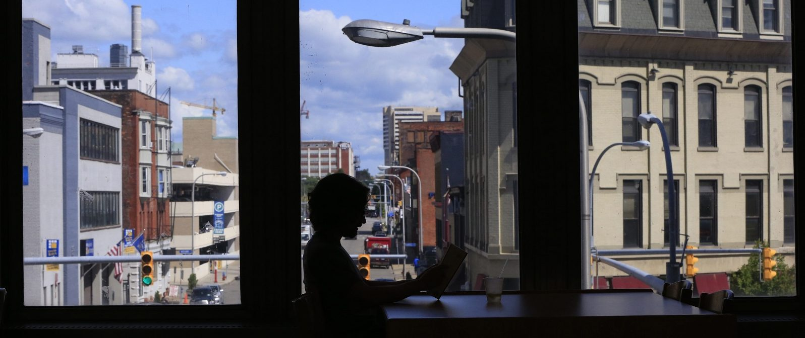 Whether it's the massive Buffalo and Erie County Central Library or a smaller local library, take some time alone to explore literature. (Harry Scull Jr./Buffalo News file photo)