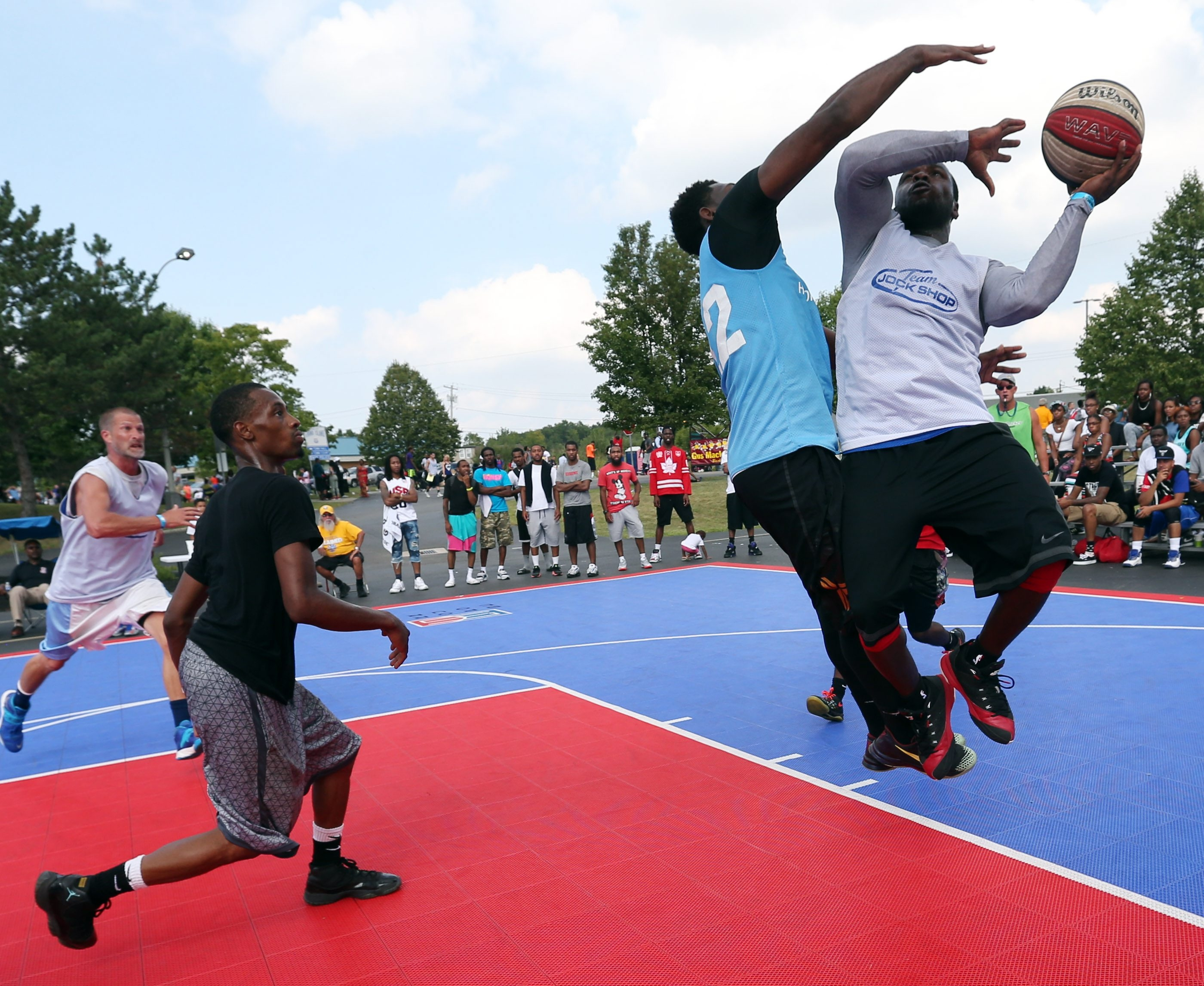 Maceo Wofford of Team Jock Shop shoots against BVO's John Black in the top men's championship game in the Gus Macker Tournament on Grand Island.