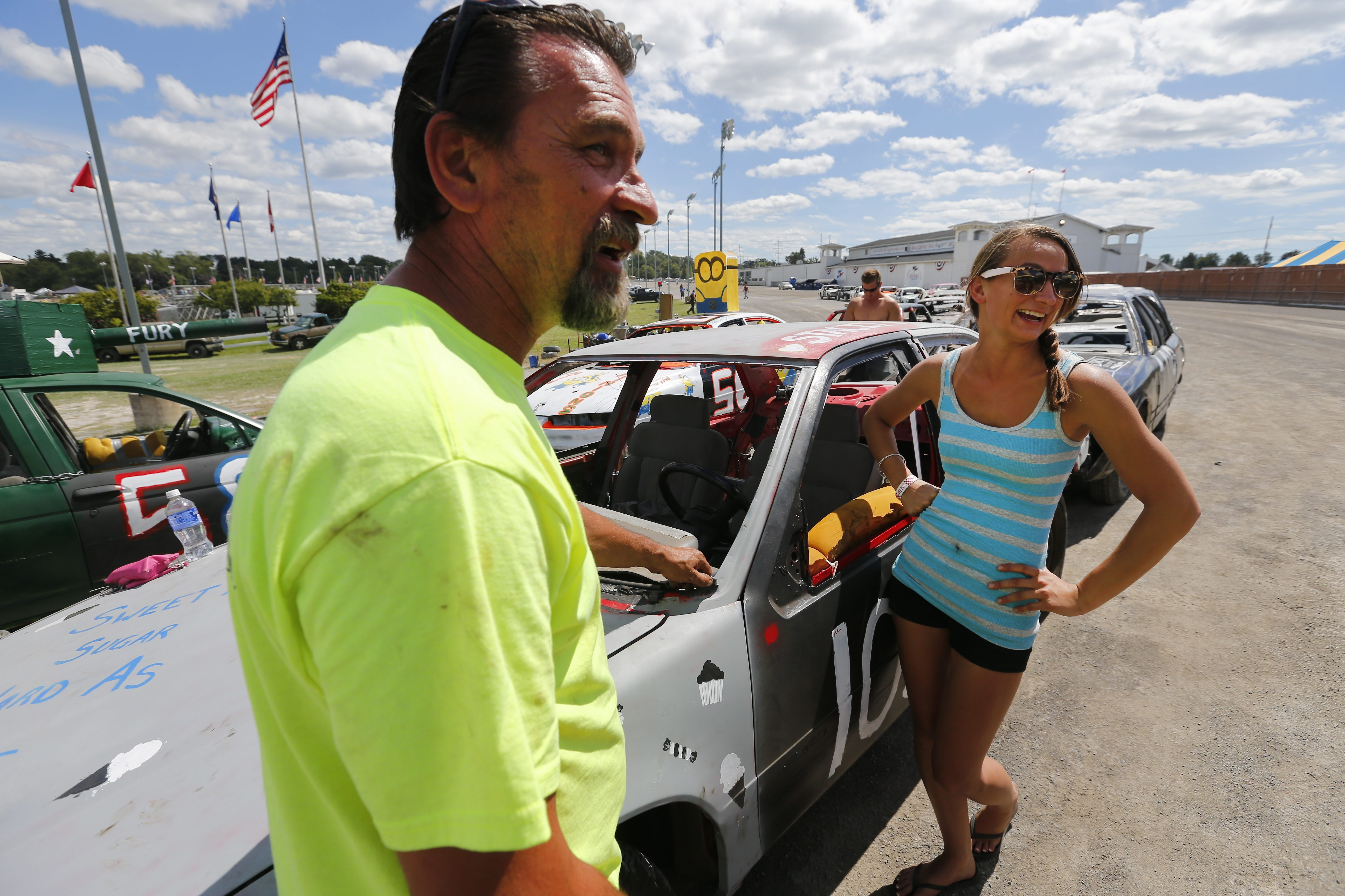 Paul Haniszewski helps get daughter Stacey ready for the Demolition Derby at the Erie County Fair in Hamburg on Sunday. Father and daughter both competed Sunday to pay tribute to Ed Haniszewski, who was the first demo driver in the family.