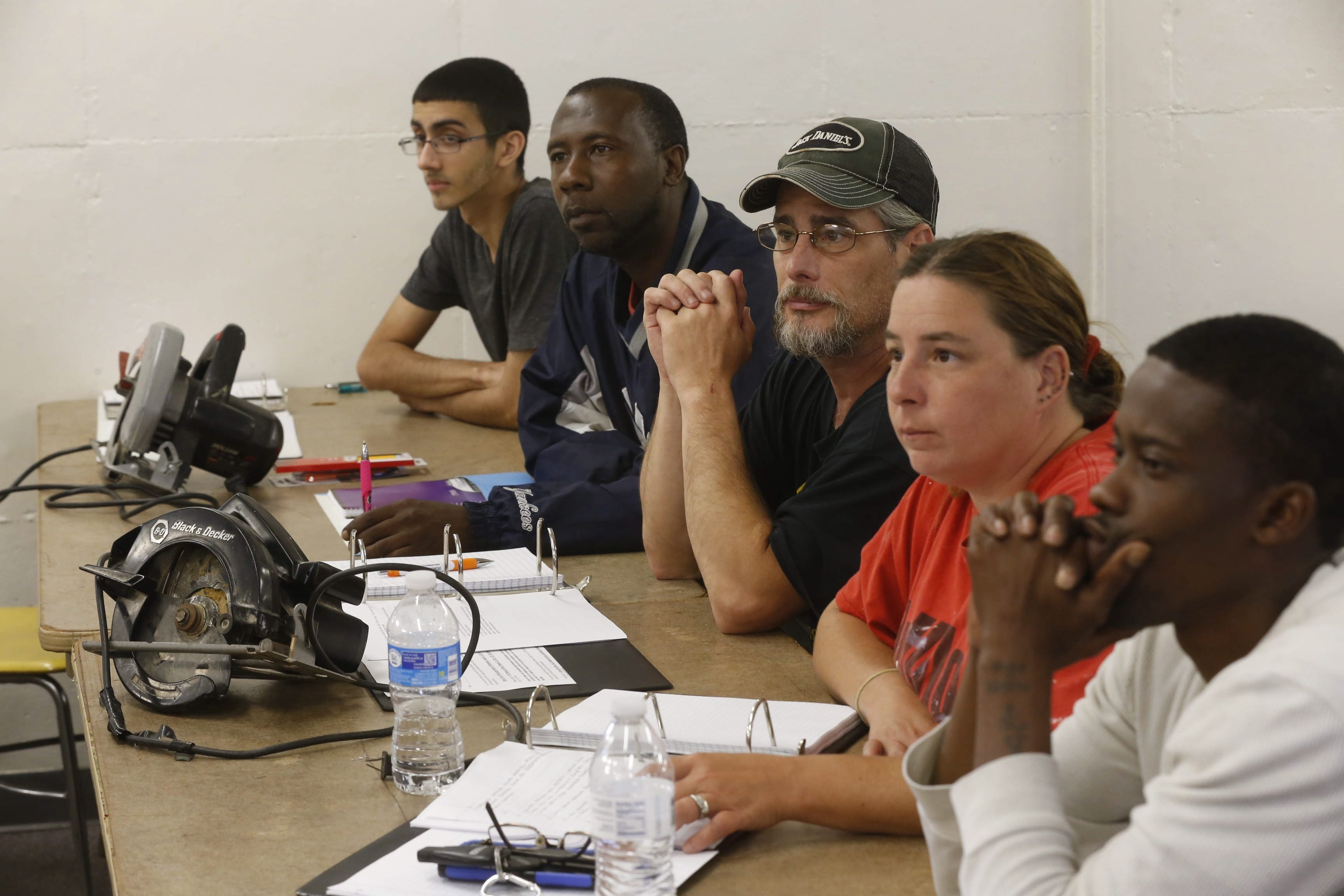 Students, from left, Hernan Velez, James Cowart, Philip Marshanke, Kathrine Hudson and Christopher Johnson listen to instructions at the Isaiah 61 Project classroom at 1609 22nd St., Niagara Falls.