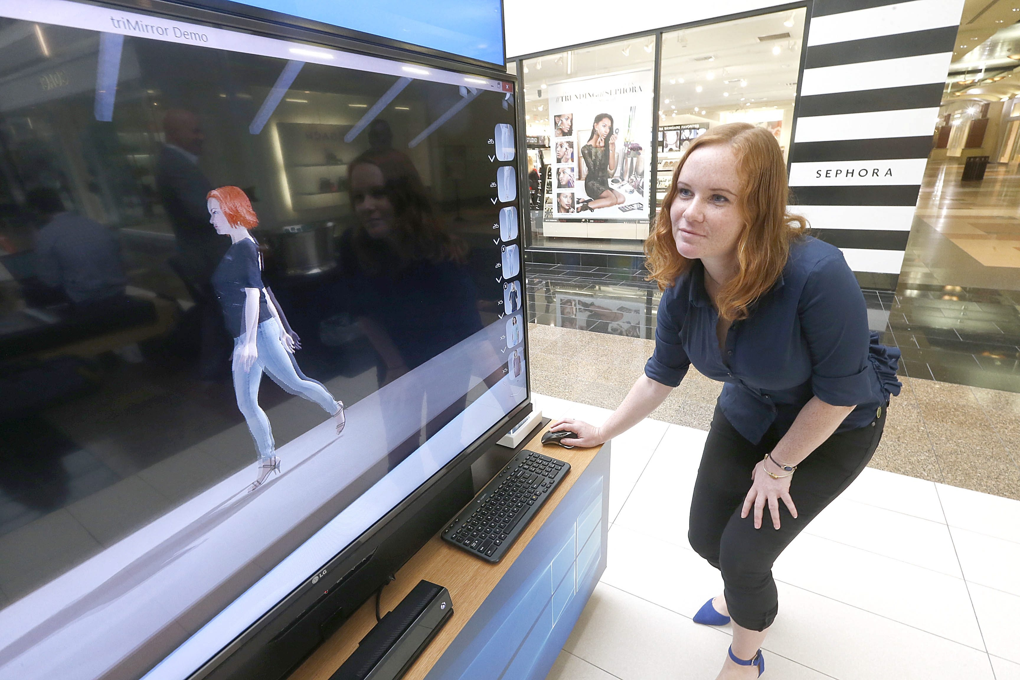 Jenny Tcharnaia, co-founder and CFO of triMirror, demonstrates use of the fashion-imaging software outside the Microsoft Store at the Walden Galleria on Thursday. triMirror was one of the winners of the 43North business plan competition.