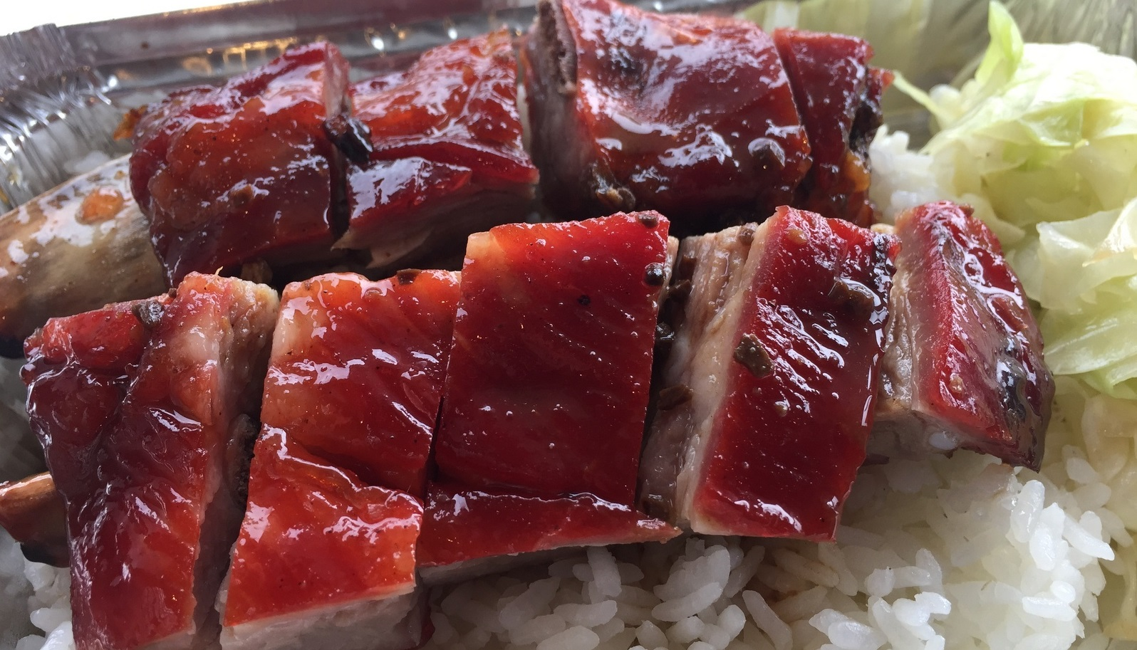 Pork spare ribs, rice and cabbage, $5.25 from Eddie's Chophouse. (Andrew Galarneau/Buffalo News)