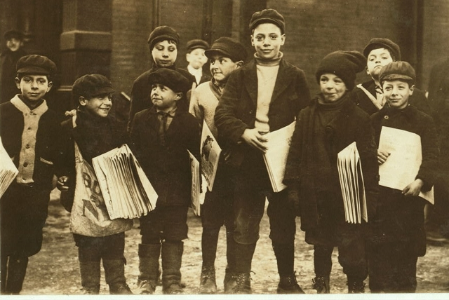 Lewis Hine's 1910 photos of Buffalo newsies include this one with the caption: 'Some of the youngest newsies hanging around the paper office after school. Location: Buffalo, New York (State)' (Photo from the Library of Congress National Child Labor Committee Collection)