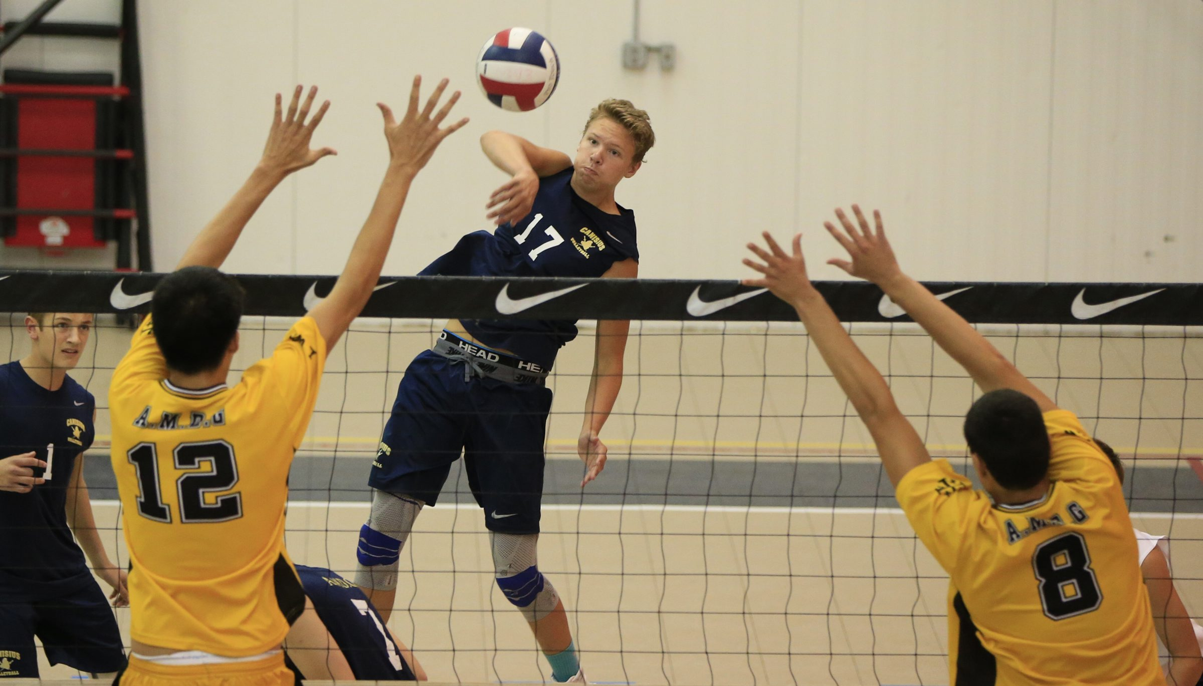 Canisius's Devin Joslyn returns a ball against McQuaid during  the finals of the Eden Pan-Am boys volleyball tournament  at Buffalo Niagara Center Court volleyball on Sept. 12.  (Harry Scull Jr./Buffalo News)