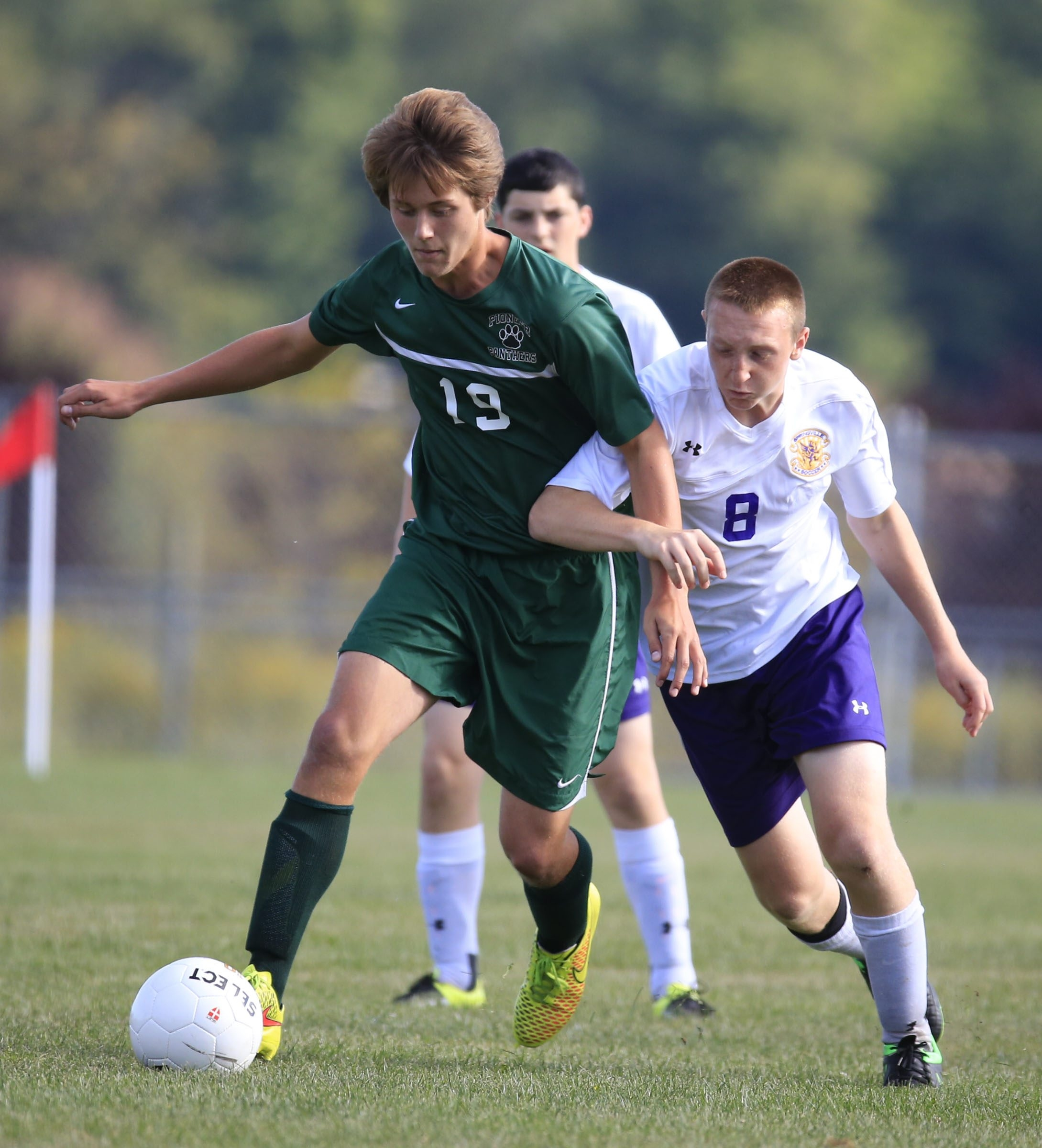 Springville's Matthew Scion and Pioneer's Kyle Burley battle during the first half of Friday's game.