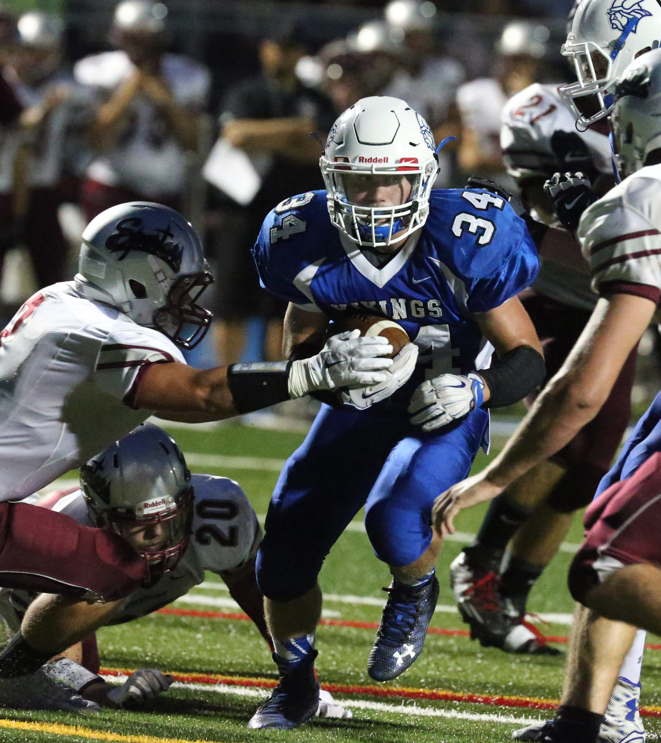 Grand Island's Jarod Brandon beats Starpoint's Austin Bowden for a first down in the first quarter at Grand Island High School in Grand Island,NY on Friday, Sept. 18, 2015.  (James P. McCoy/ Buffalo News)