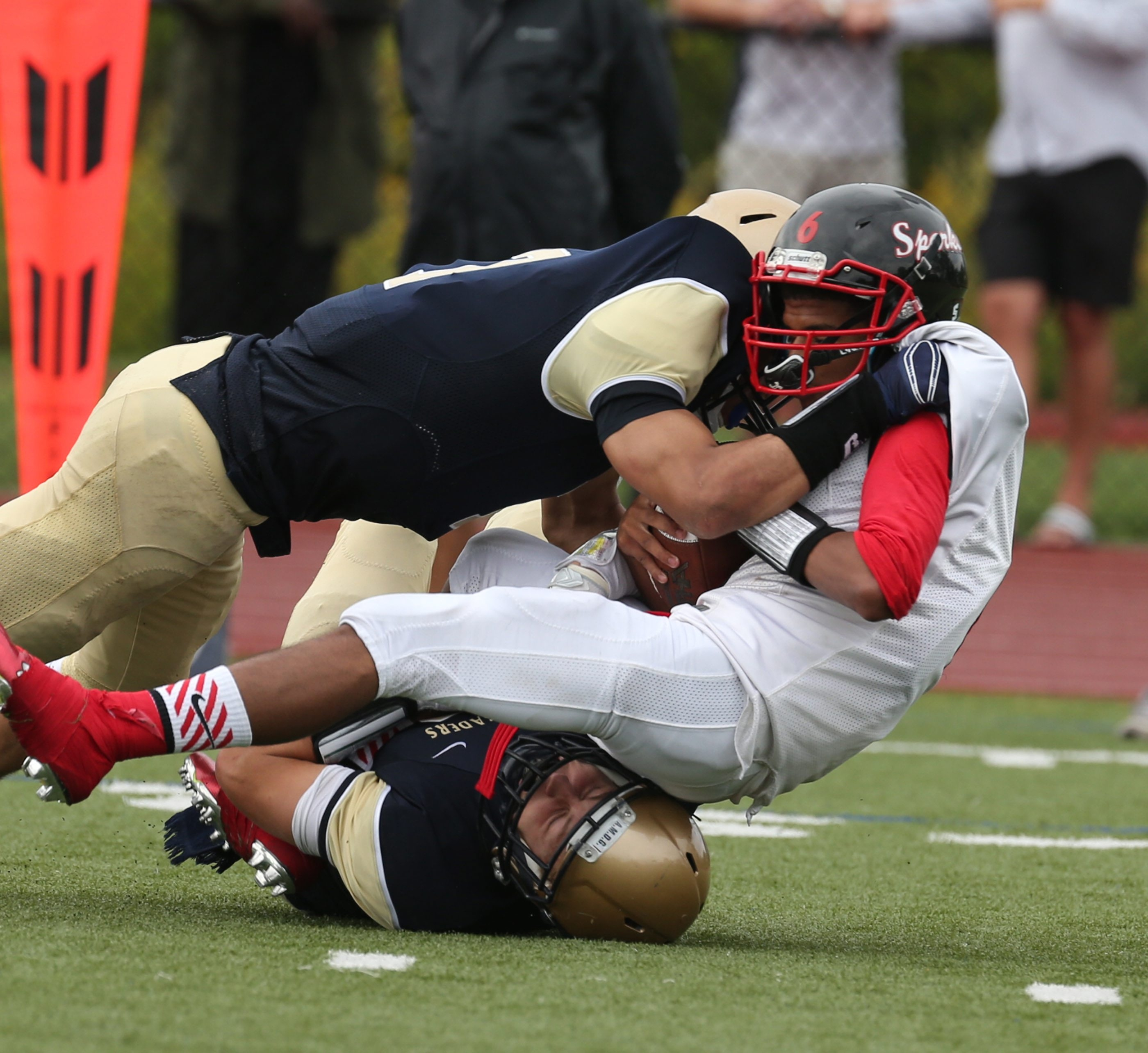 Canisius' Justin Jones and Jake Lutz sack South Park's Tyree Brown for a loss in the third quarter of Saturday's game.