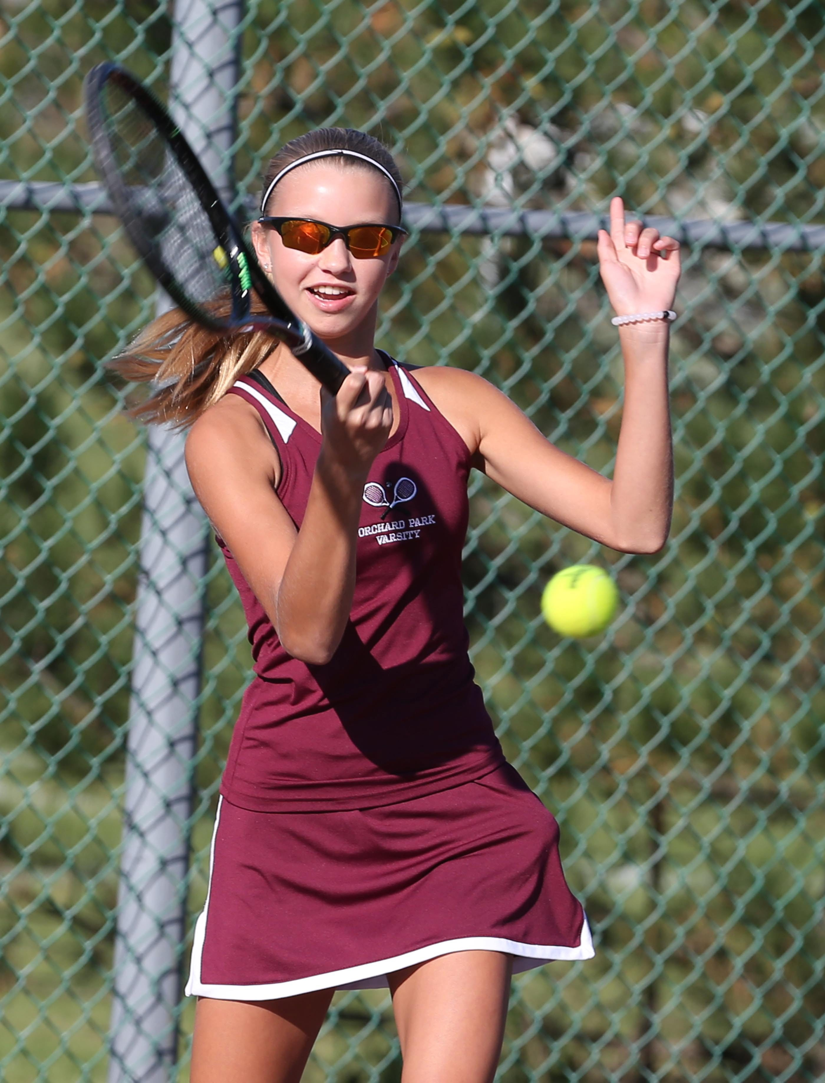 Orchard Park's first singles player, Jesse Hollins, hits the ball at West Seneca West.