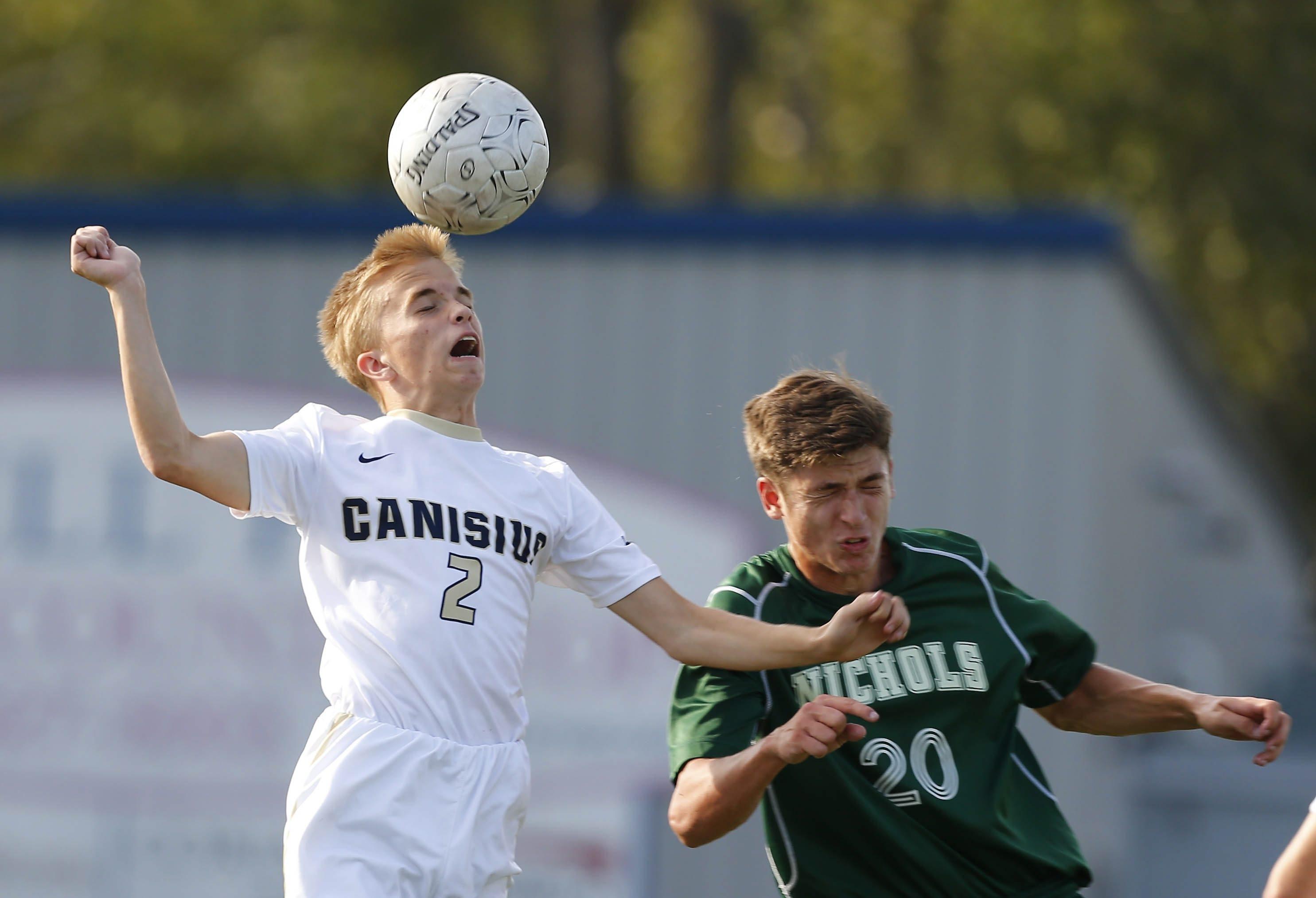 Canisius' Cameron Ciesielski heads the ball past Nichols' Matthew Calleri during Thursday's Monsignor Martin Association game.