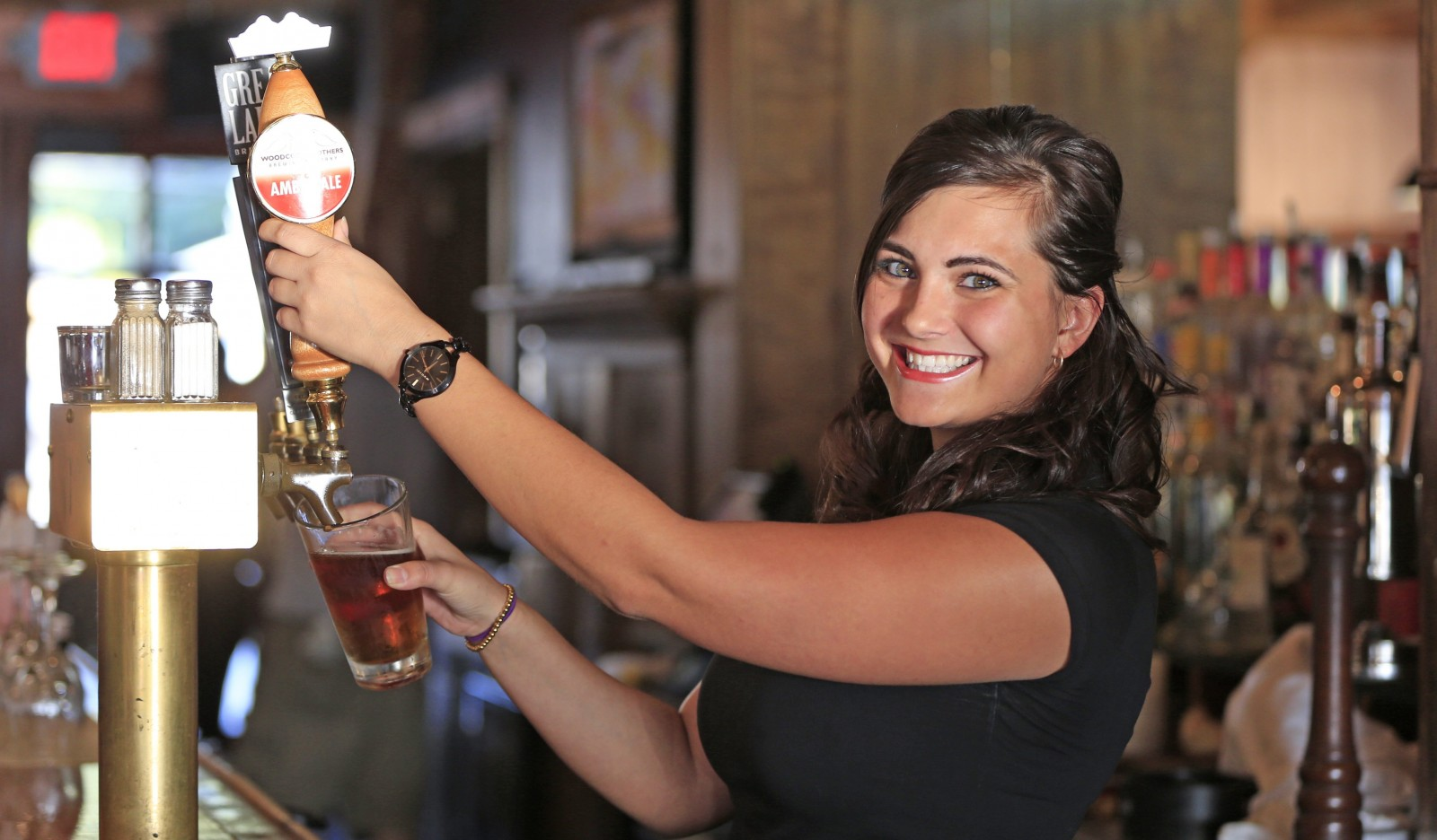 Stephanie Schmidt pours a draft beer at the Water Street Landing.  (Harry Scull Jr./Buffalo News)