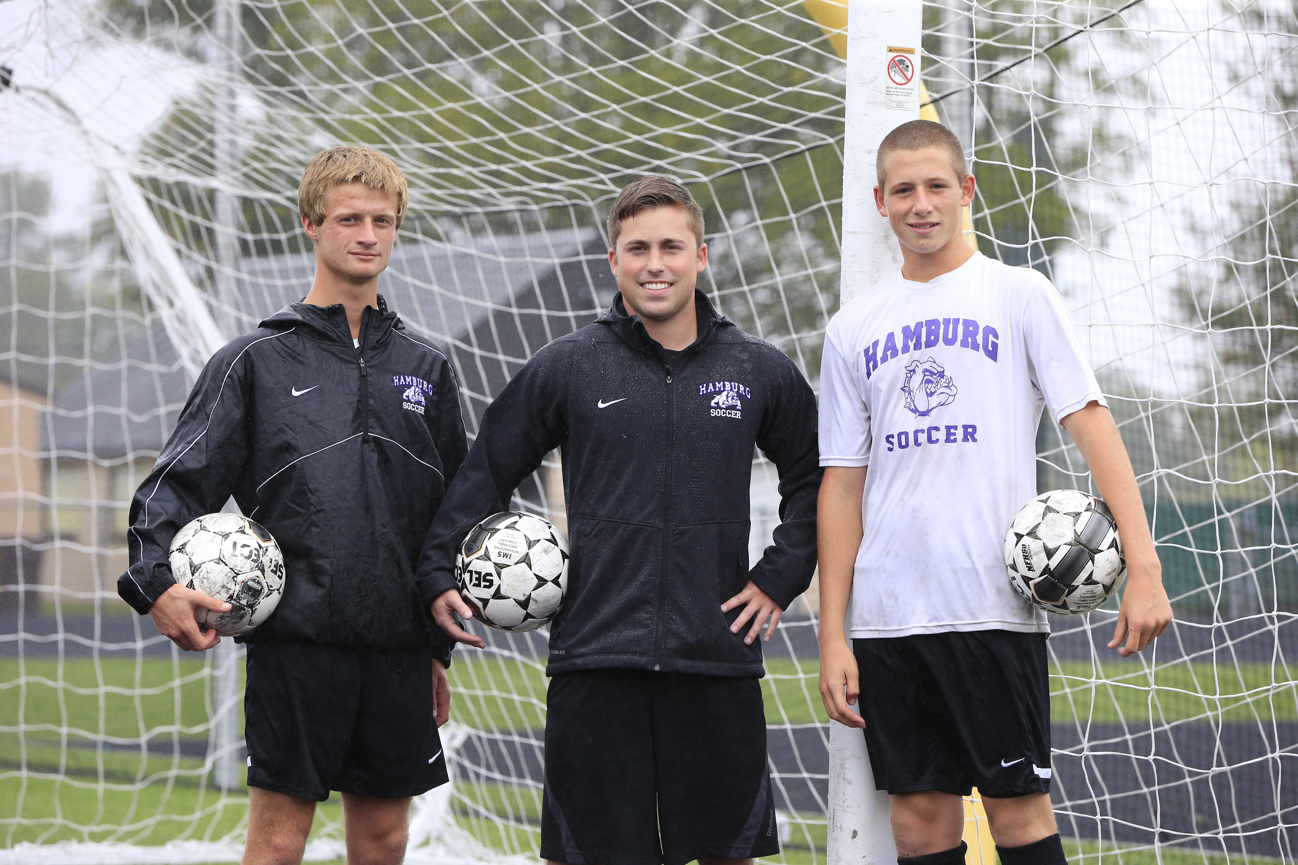 Hamburg boys soccer coach Tony Schiappa, center, poses with top players Will Smith, left, and Justus Hoffman at Hamburg High School on Monday.