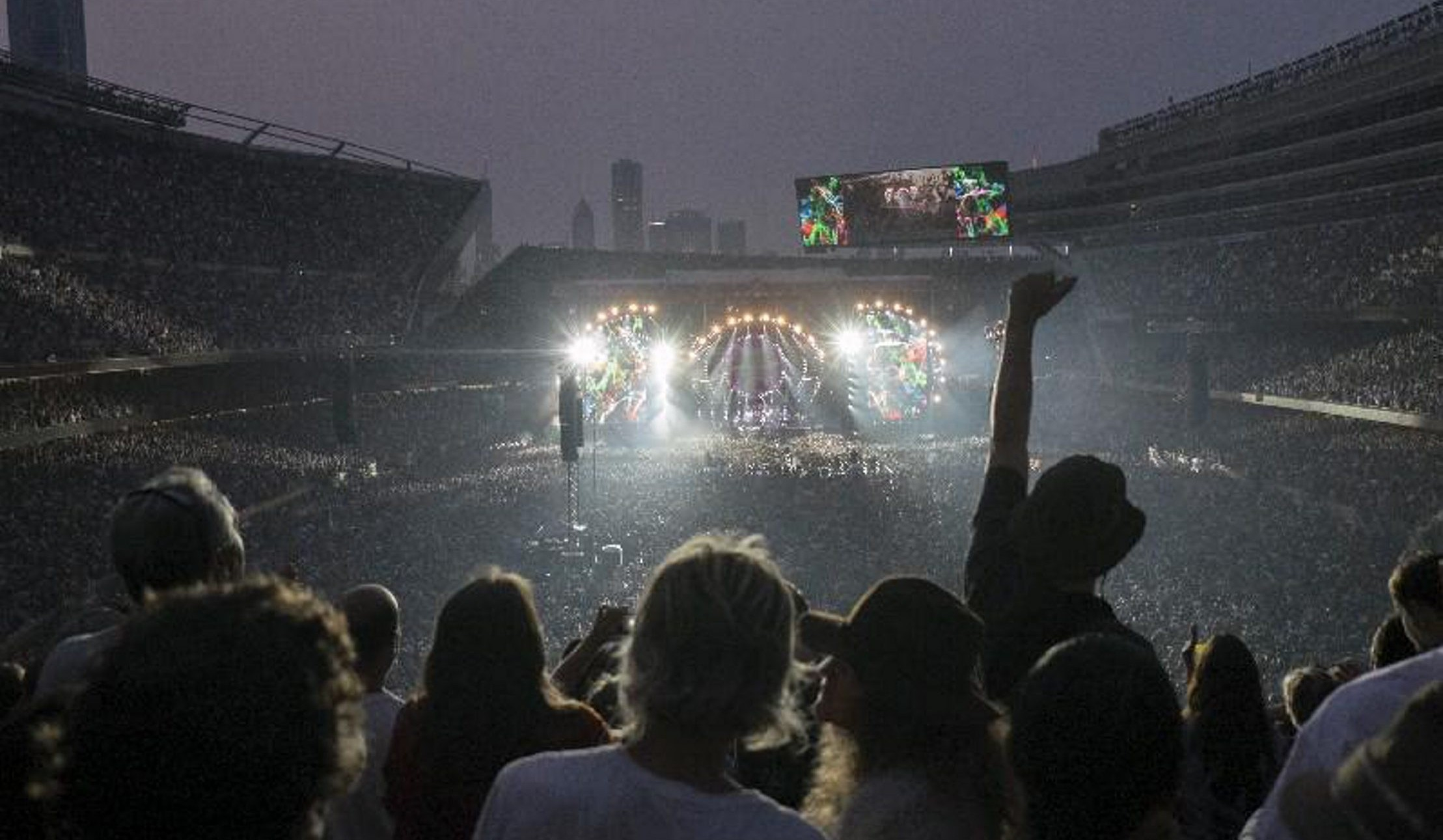 Fans cheer at the final Grateful Dead show at Soldier Field this summer. (Bryan R. Smith/The New York Times)