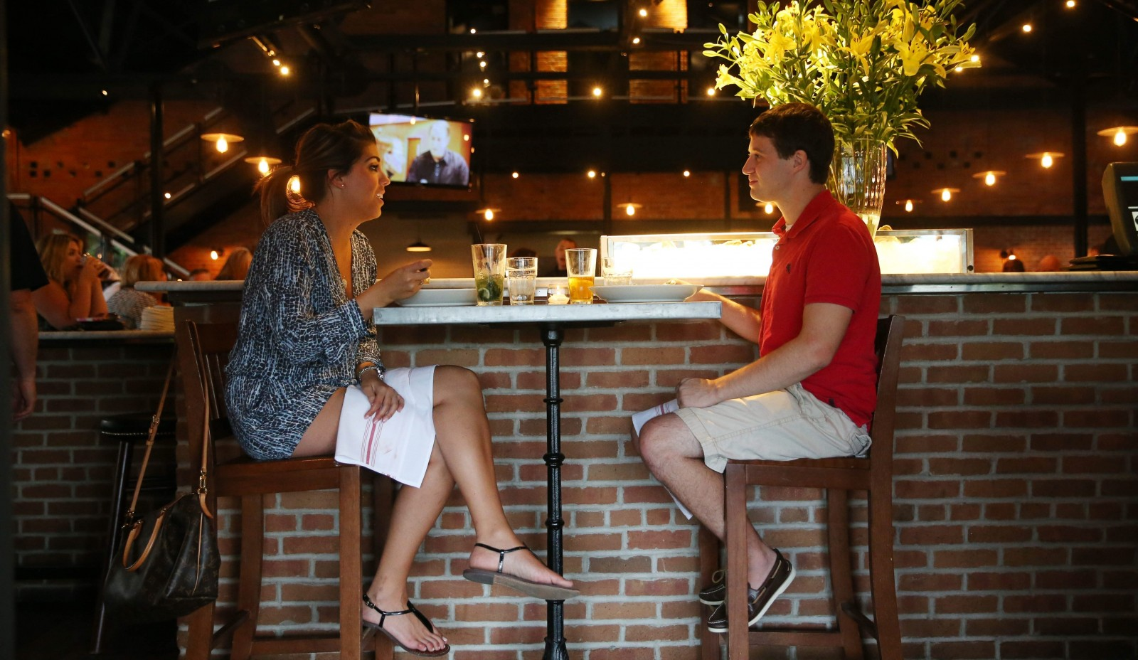 Rachel O'Connor and John Valkwitch of Amherst have dinner and drinks at the end of the horseshoe-shaped bar at the Remington Tavern in North Tonawanda. (Sharon Cantillon/Buffalo News)