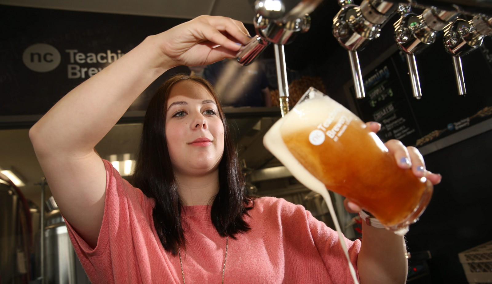 Student Karen Belfry pours one of Niagara College Teaching Brewery's house brands, which include the flagship Butler's Bitters, at the brewery's retail outlet, run by students.