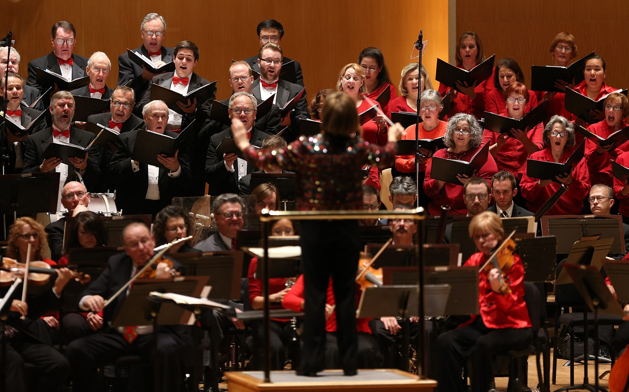 Conductor JoAnn Falletta leads the orchestra and the chorus during the Buffalo Philharmonic Orchestra's Classical Christmas program at Kleinhans Music Hall in Buffalo on Dec. 6, 2012. The BPO received a $1 million donation on Wednesday from Louis P. Ciminelli.