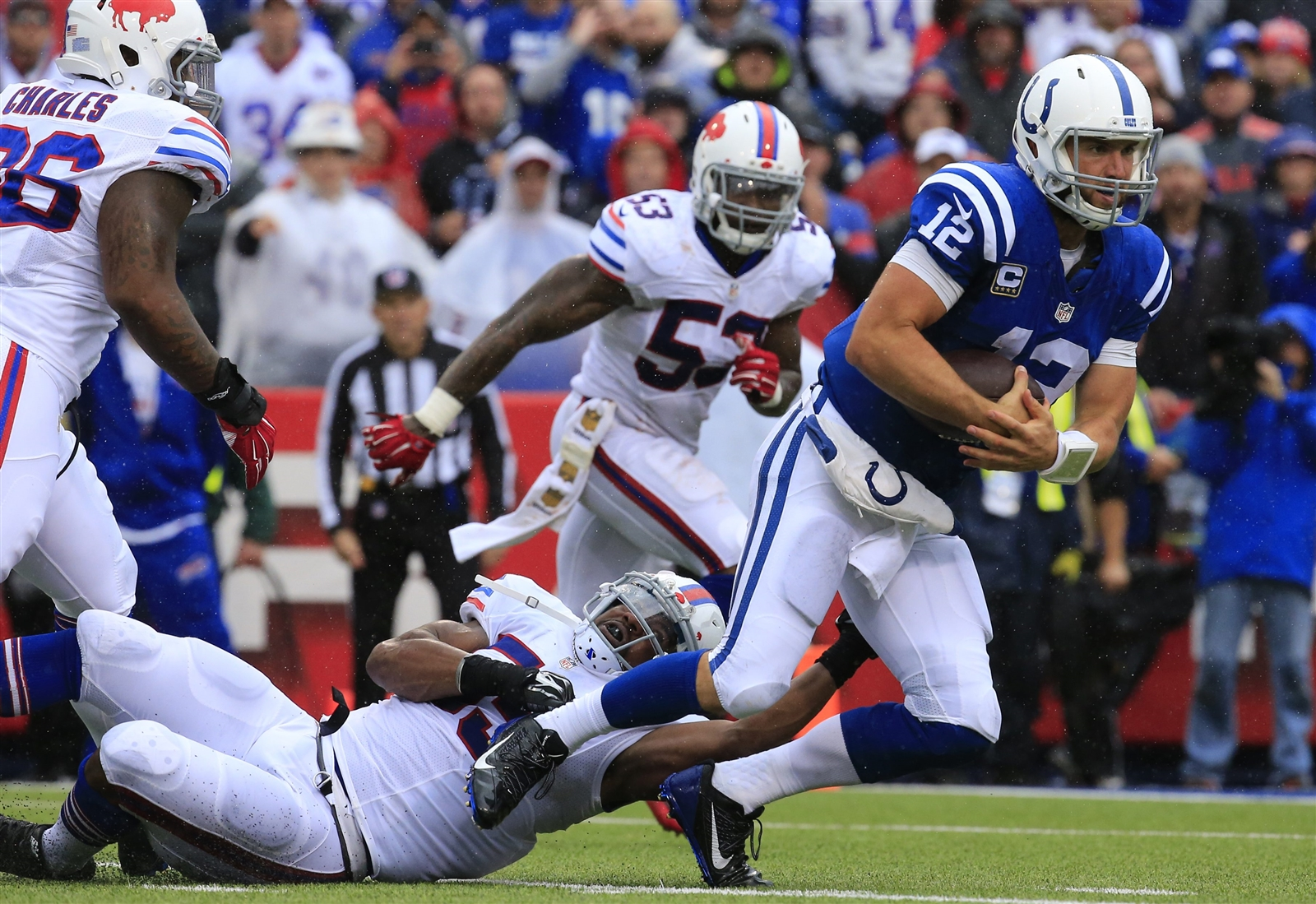 Jerry Hughes tackles Andrew Luck during the fourth quarter. (Harry Scull Jr./Buffalo News)