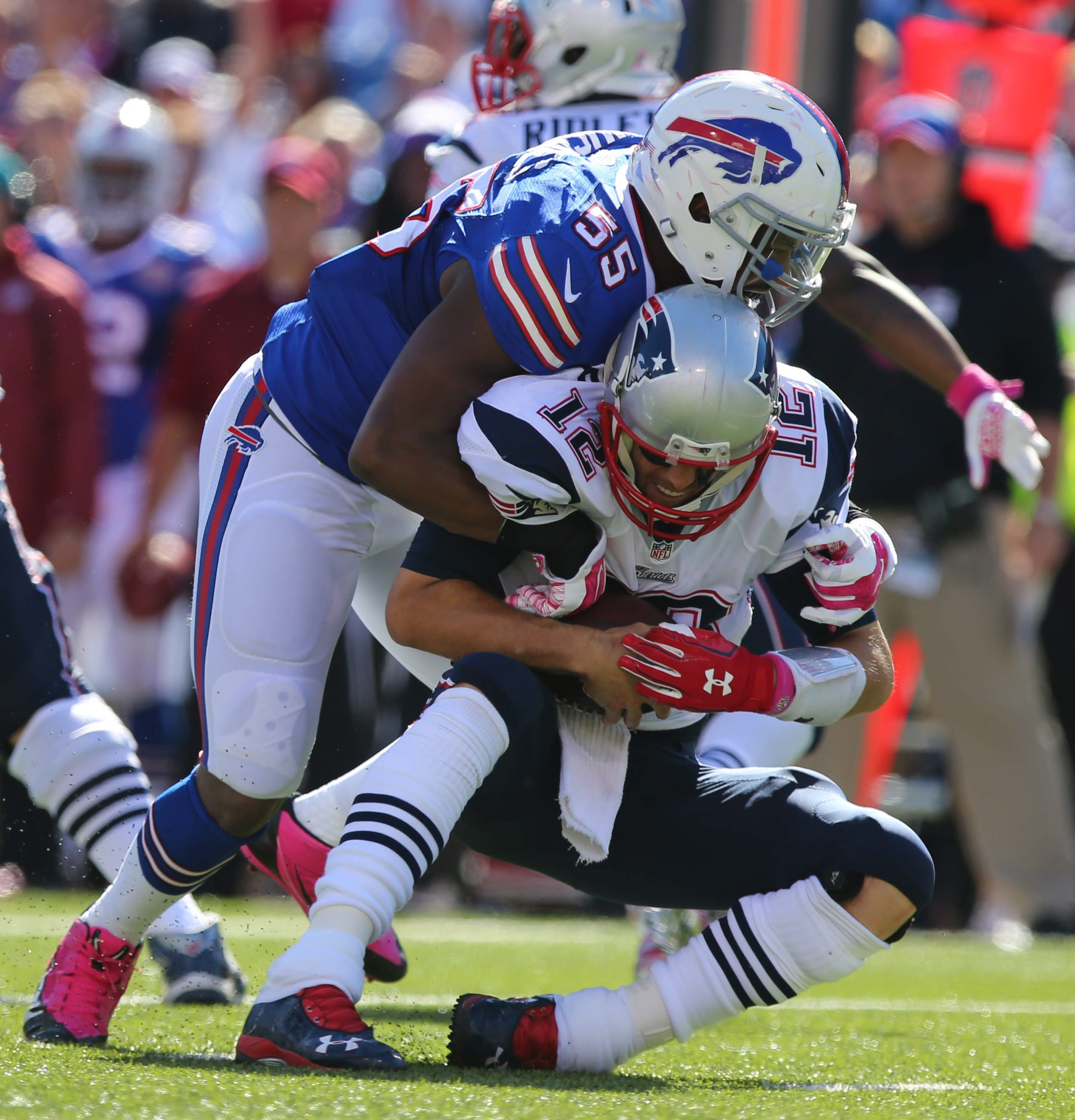 2LINE CUTLINE Buffalo Bills defensive end Jerry Hughes (55) sacks New England Patriots quarterback Tom Brady (12) during the first half at Ralph Wilson Stadium, Sunday Oct. 12, 2014.  (Mark Mulville/Buffalo News)