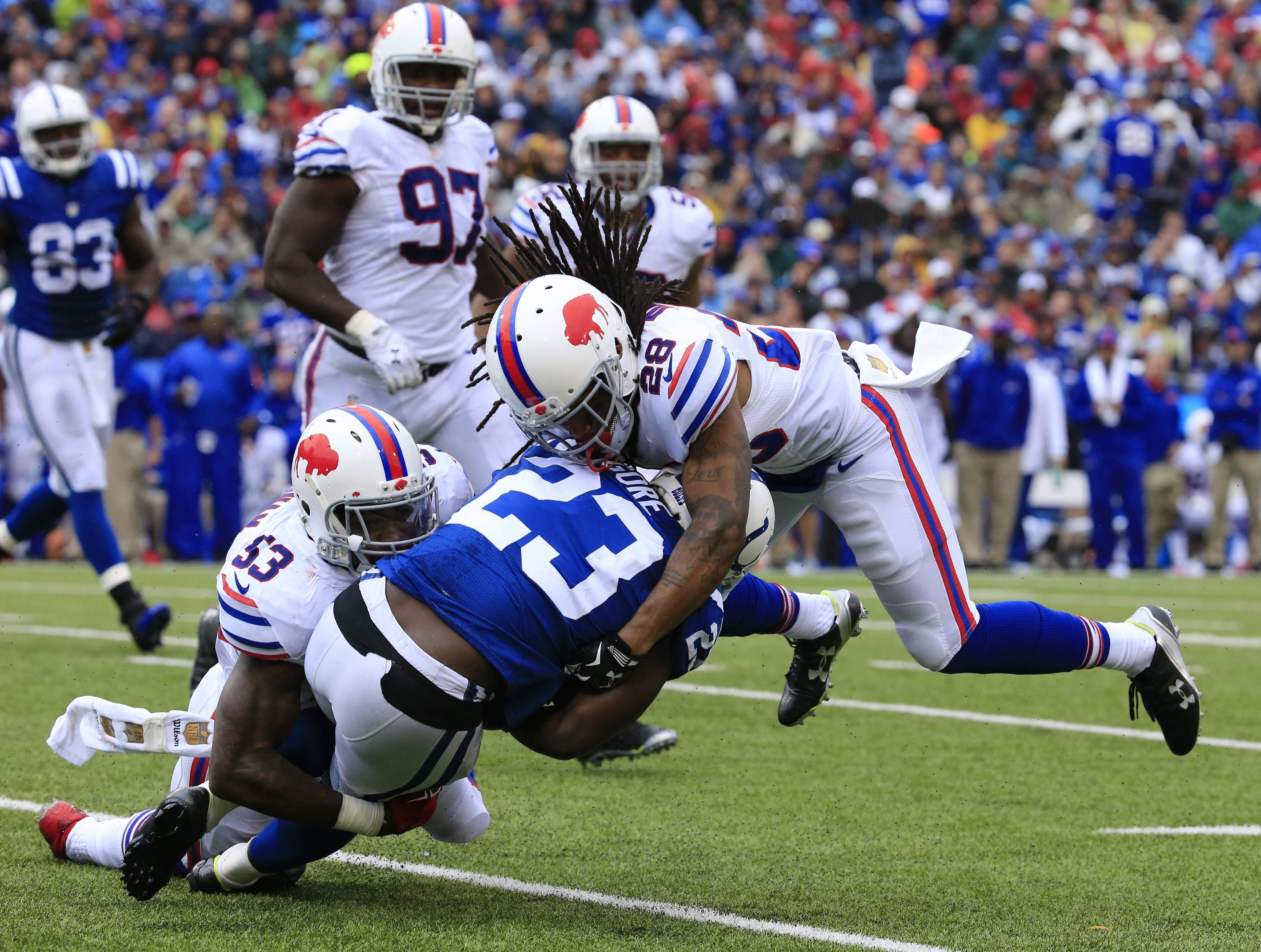 Bills defenders Nigel Bradham (53) and Ronald Darby (28) wrap up Colts running back Frank Gore (23) during the fourth quarter of Buffalo's win at home.