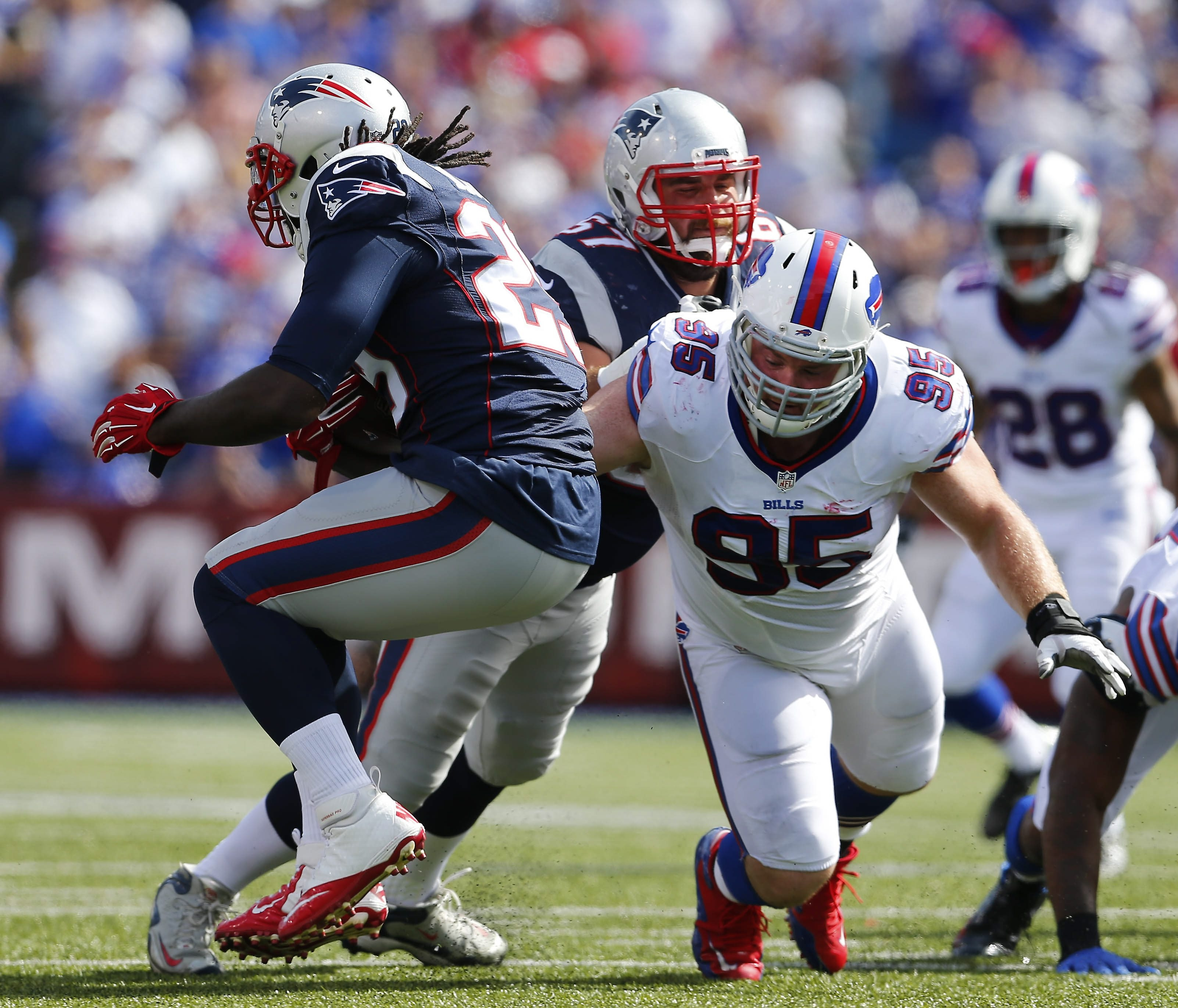 Kyle Williams, trying to tackle New England's LeGarrette Blount last Sunday, will ty to get after Dolphins quarterback Ryan Tannehill.