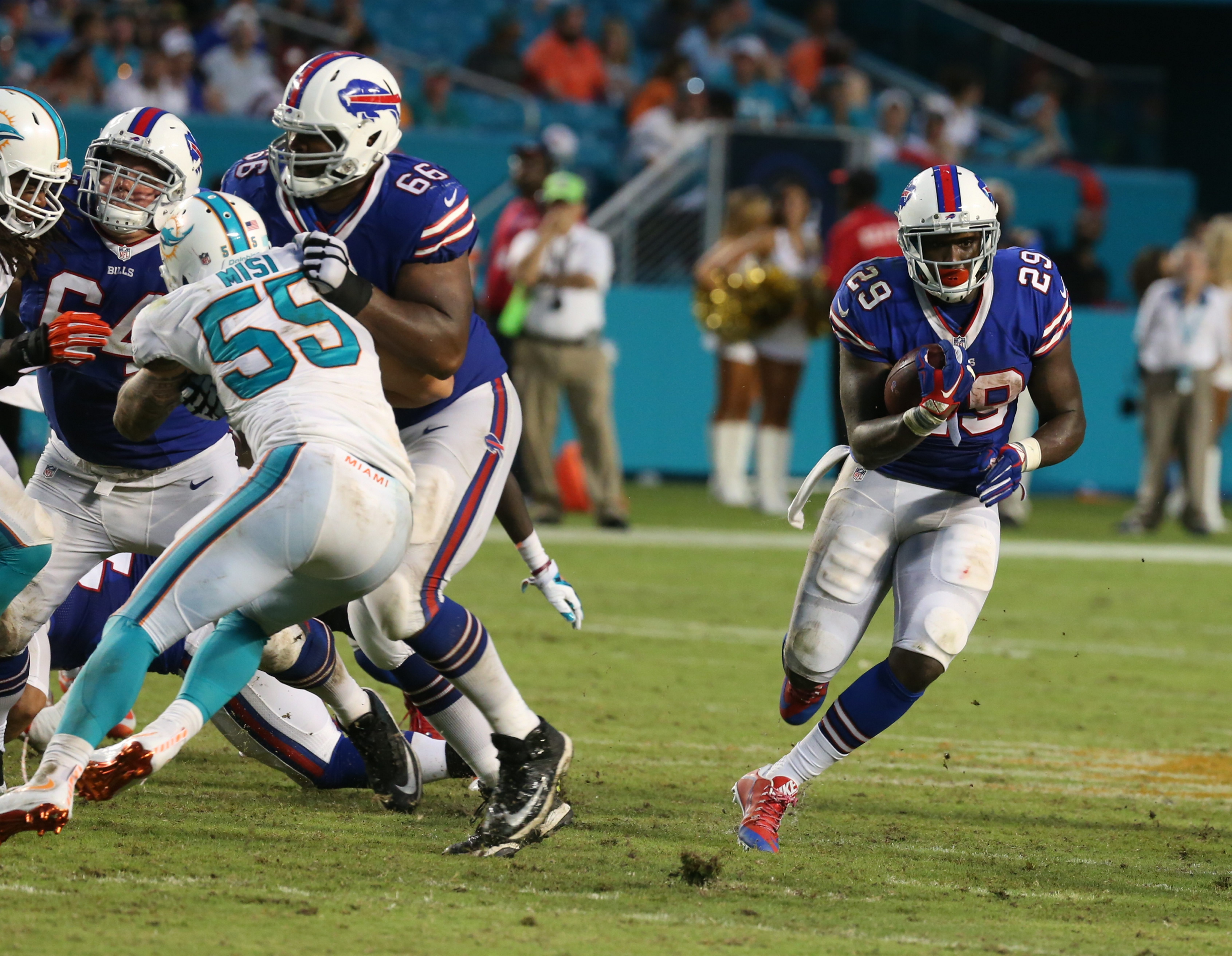 Karlos Williams (29) ran for 110 yards against Miami on Sunday while cornerback Ronald Darby (28) had one of the three Buffalo interceptions in the first half against the Dolphins.