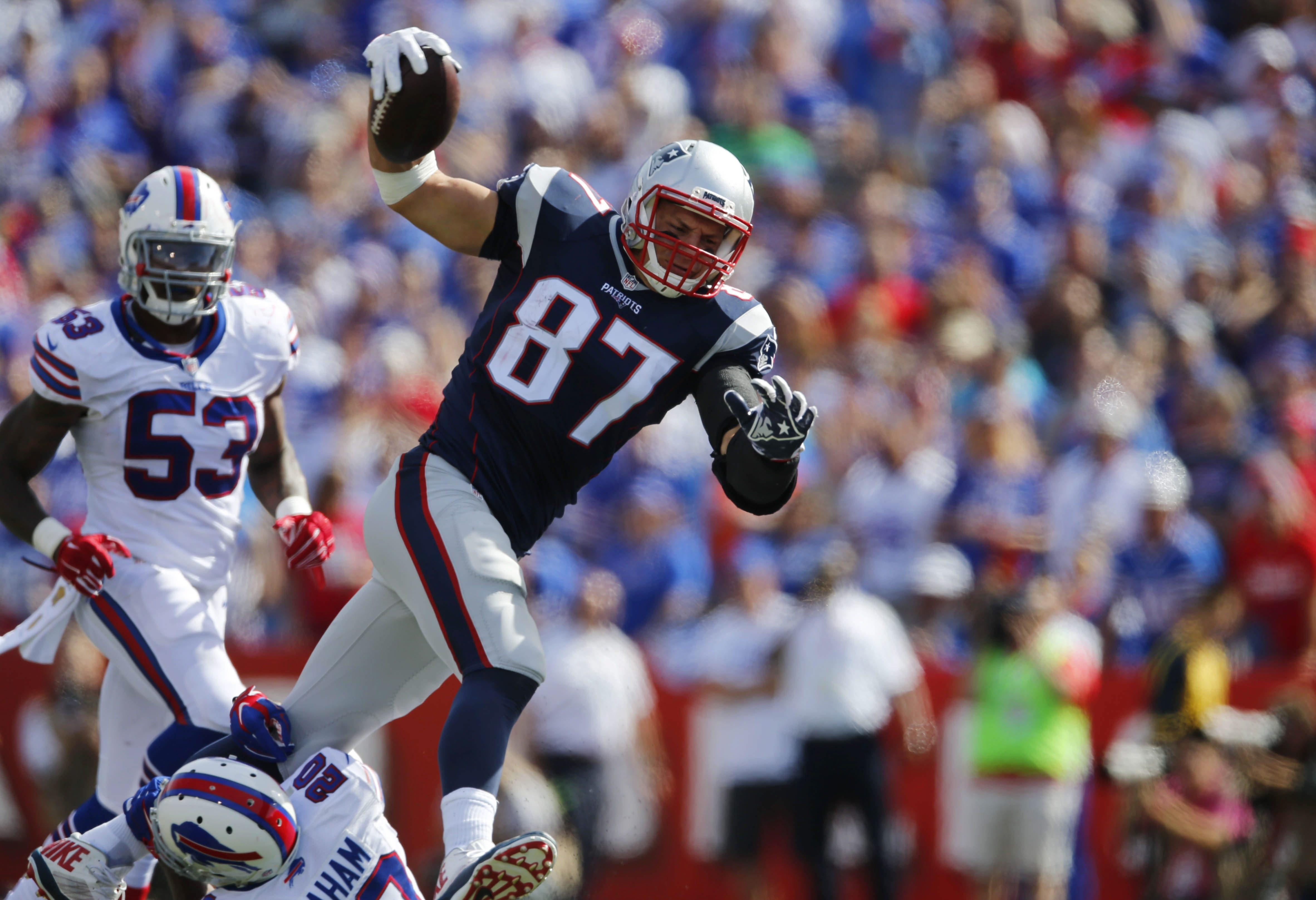 Patriots tight end Rob Gronkowski tramples Bills safety Corey Graham during the third quarter.