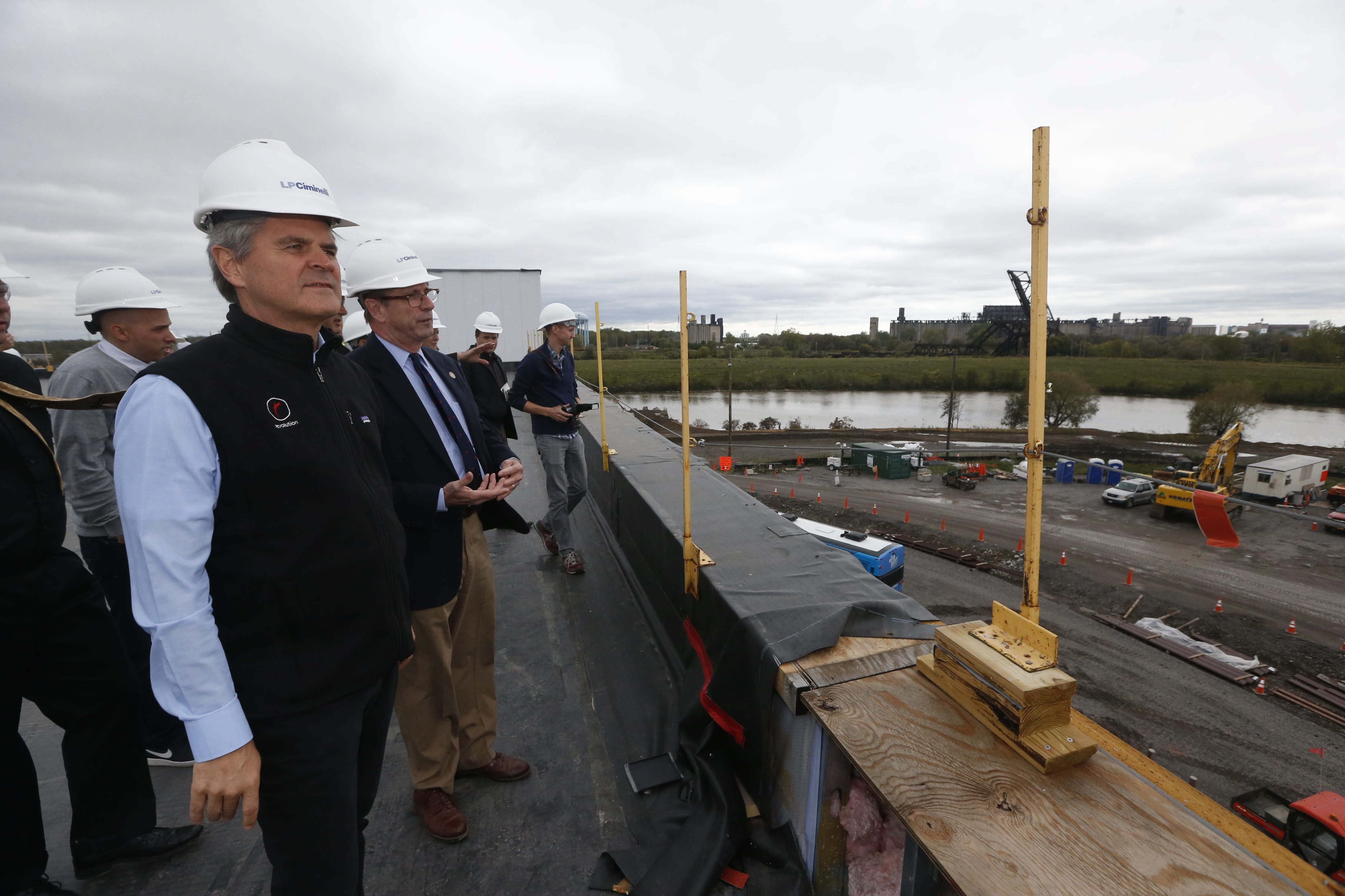 Steve Case's day included, top, Solar City with Peter K. Cutler; and from left, CanalSide with OneBuffalo beer; a tour boat with Thurman Thomas; and a chat with Robert Gioia, Erie Canal Harbor Development's chairman.