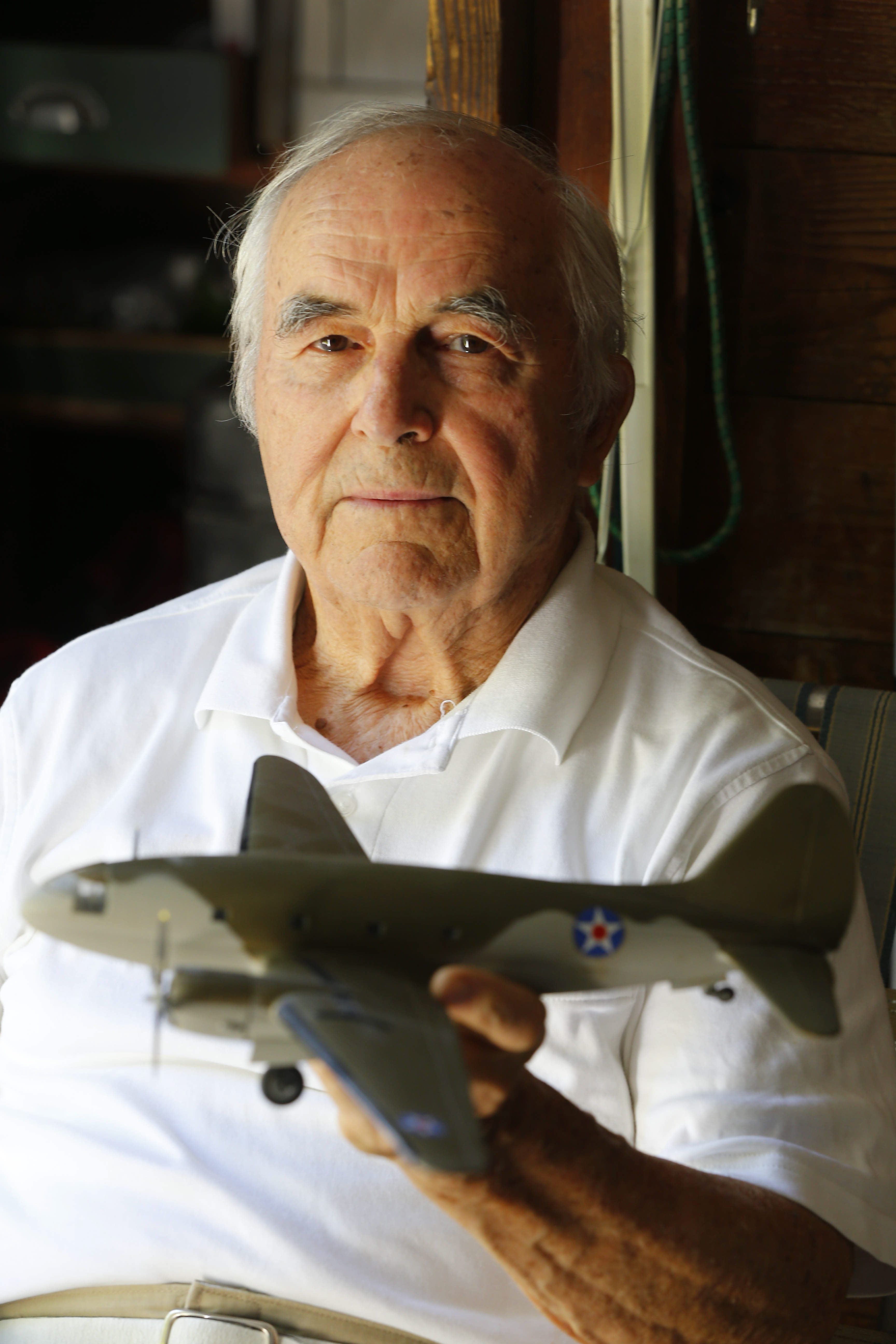 Robert J. Parks, 91, holds a model of the airplane he served on in the China-Burma-India Theater during World War II.