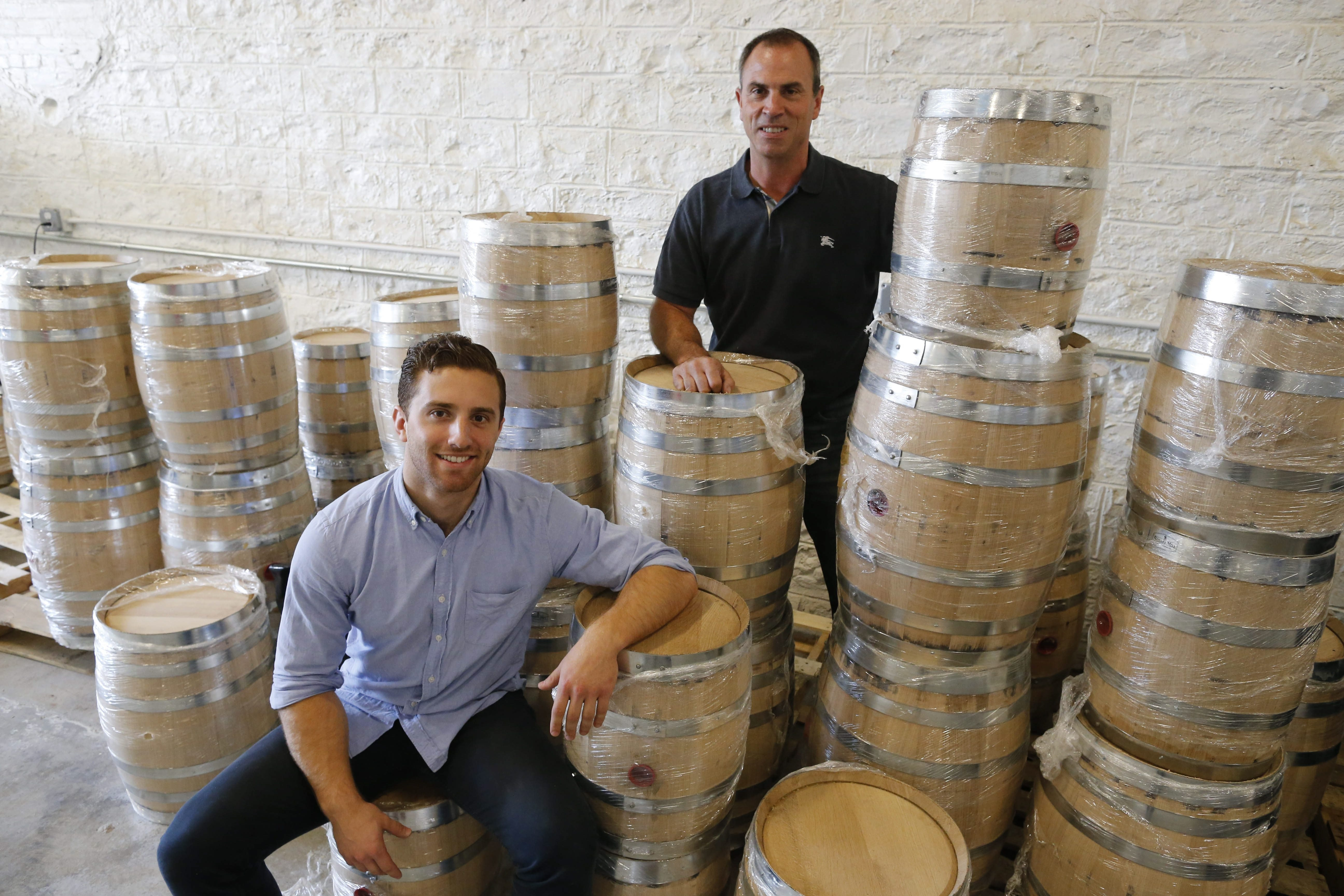 Bobby Finan, left, and Sean Insalaco are partners in Tommyrotter, makers of custom batches of gin, vodka and other spirits using New York State ingredients. (Derek Gee/Buffalo News)