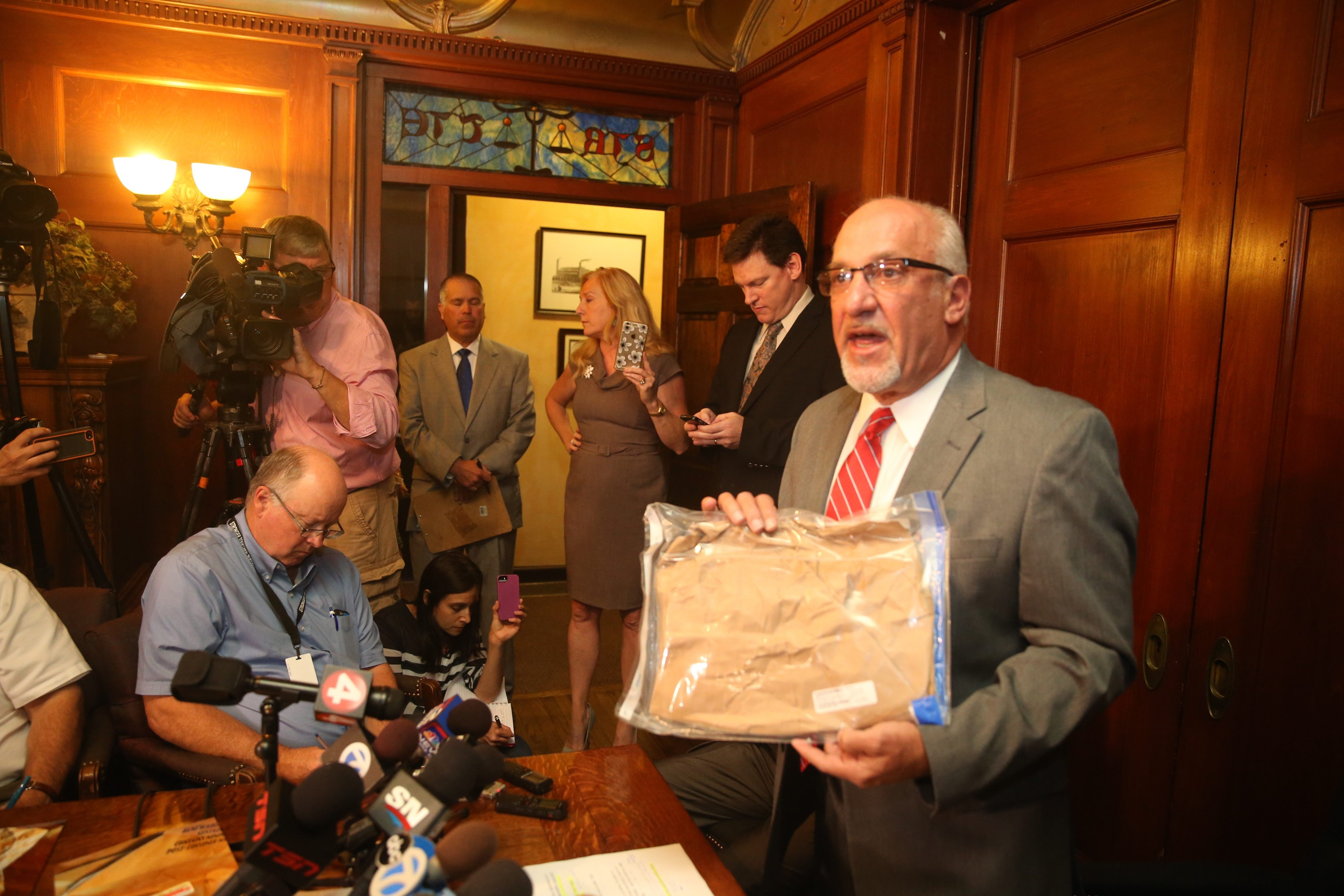 Thomas Eoannou, who represents the woman accusing hockey star Patrick Kane of rape, holds what he says is the evidence bag in the case. (John Hickey/Buffalo News)