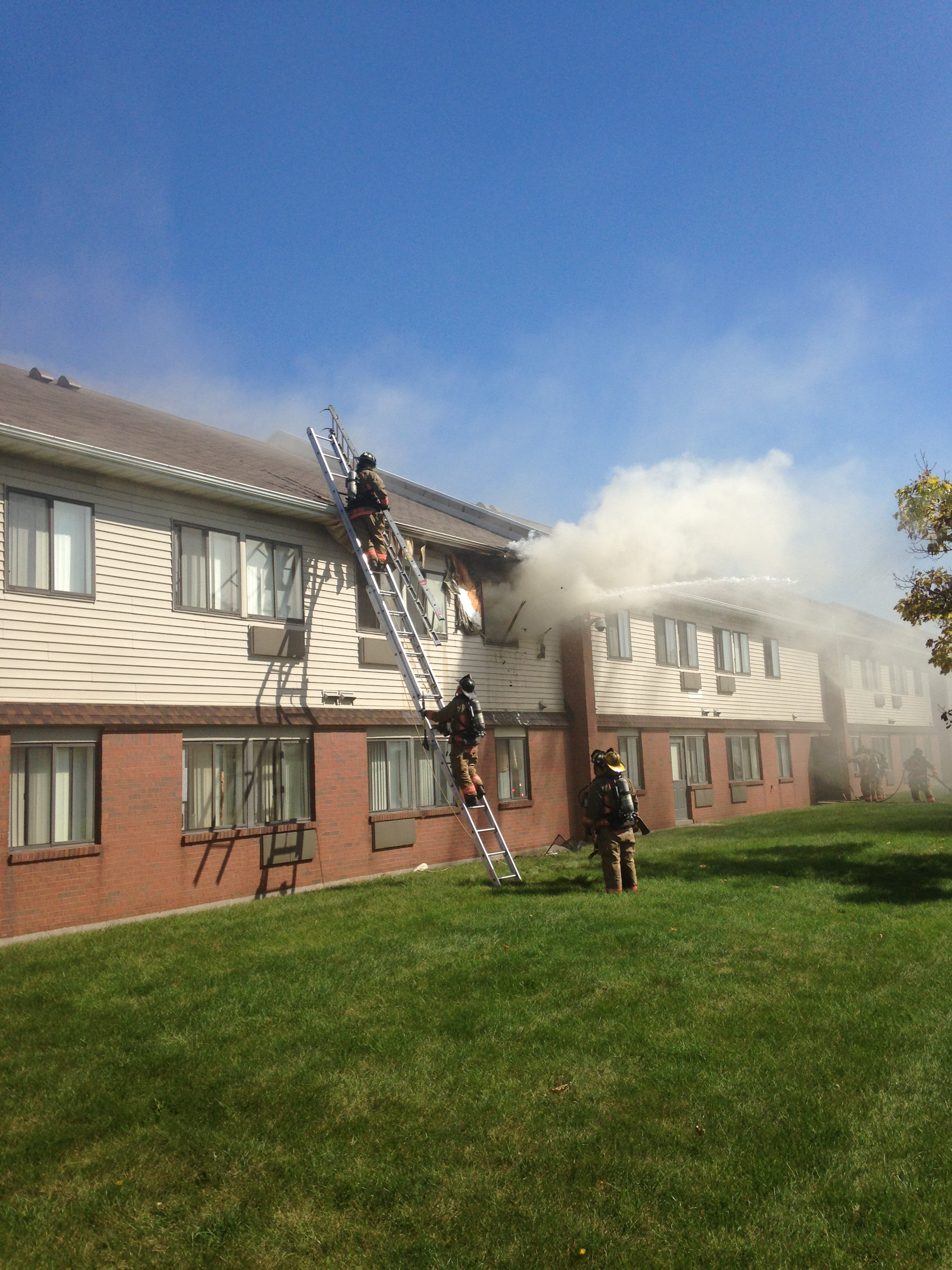 Firefighters work the scene at a blaze at 132 Spring St., site of Friendship Manor and A.C. Ware Manor apartments.  (John Hickey/Buffalo News)