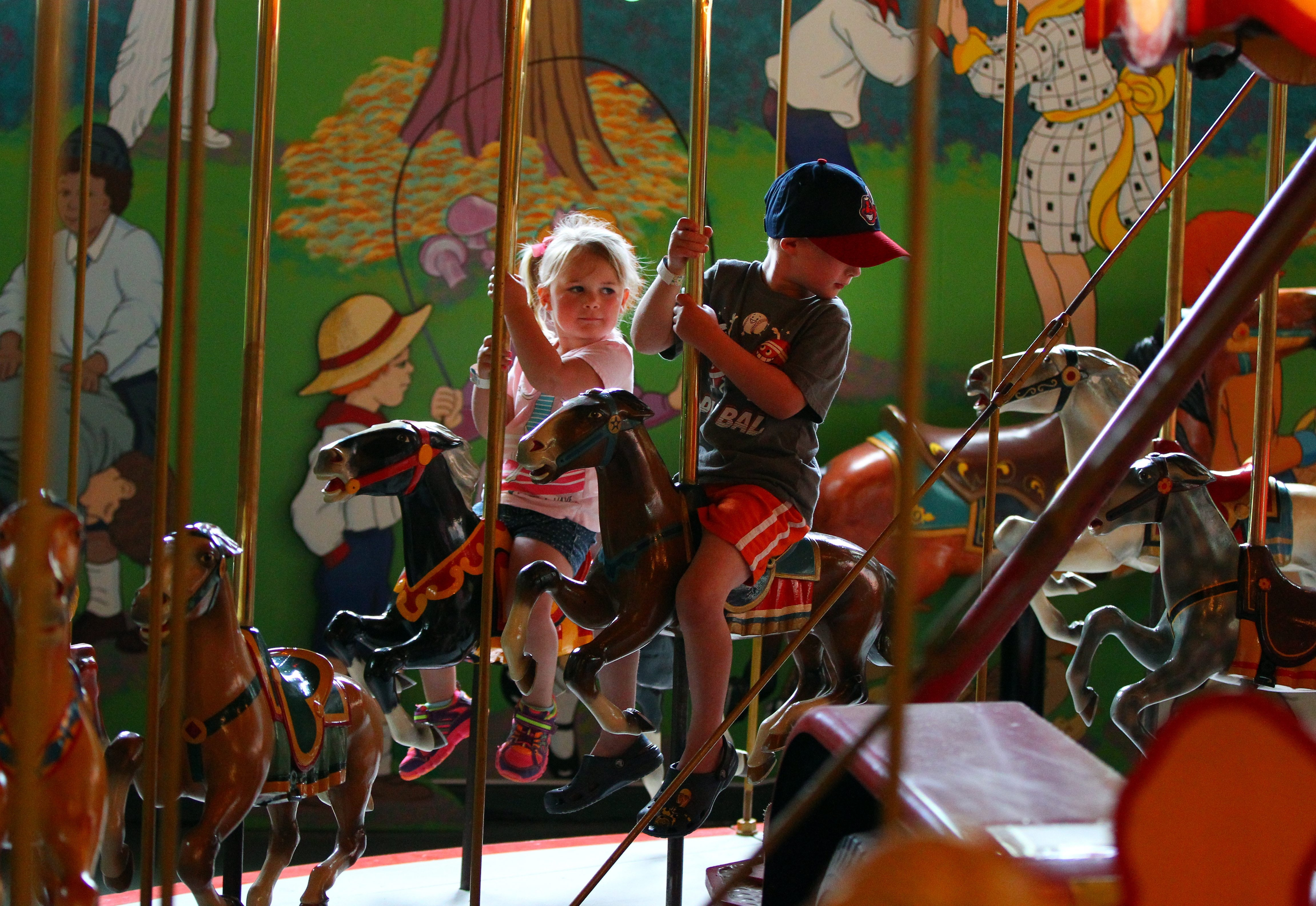 The Herschell Carrousel Factory Museum in North Tonawanda will celebrate its centennial from 10 a.m. to 4 p.m. Oct. 3. Earlier this year, Ella Thaine and her brother Carter took a ride on the museum's carousel.