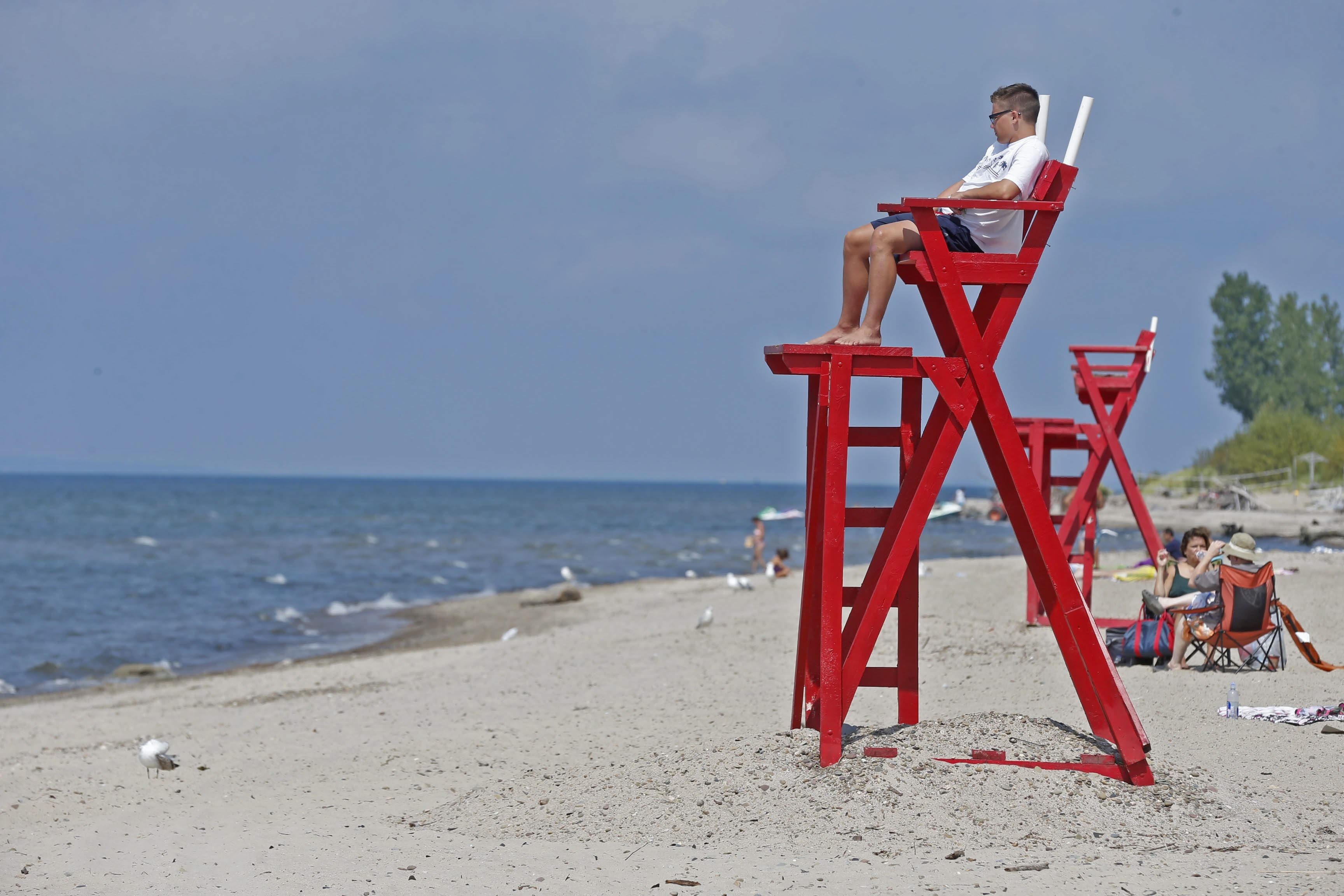 Erie County lifeguard Mike Kowalski keeps his eyes peeled watching swimmers at Bennett Beach on a rare August Sunday when the water was safe.