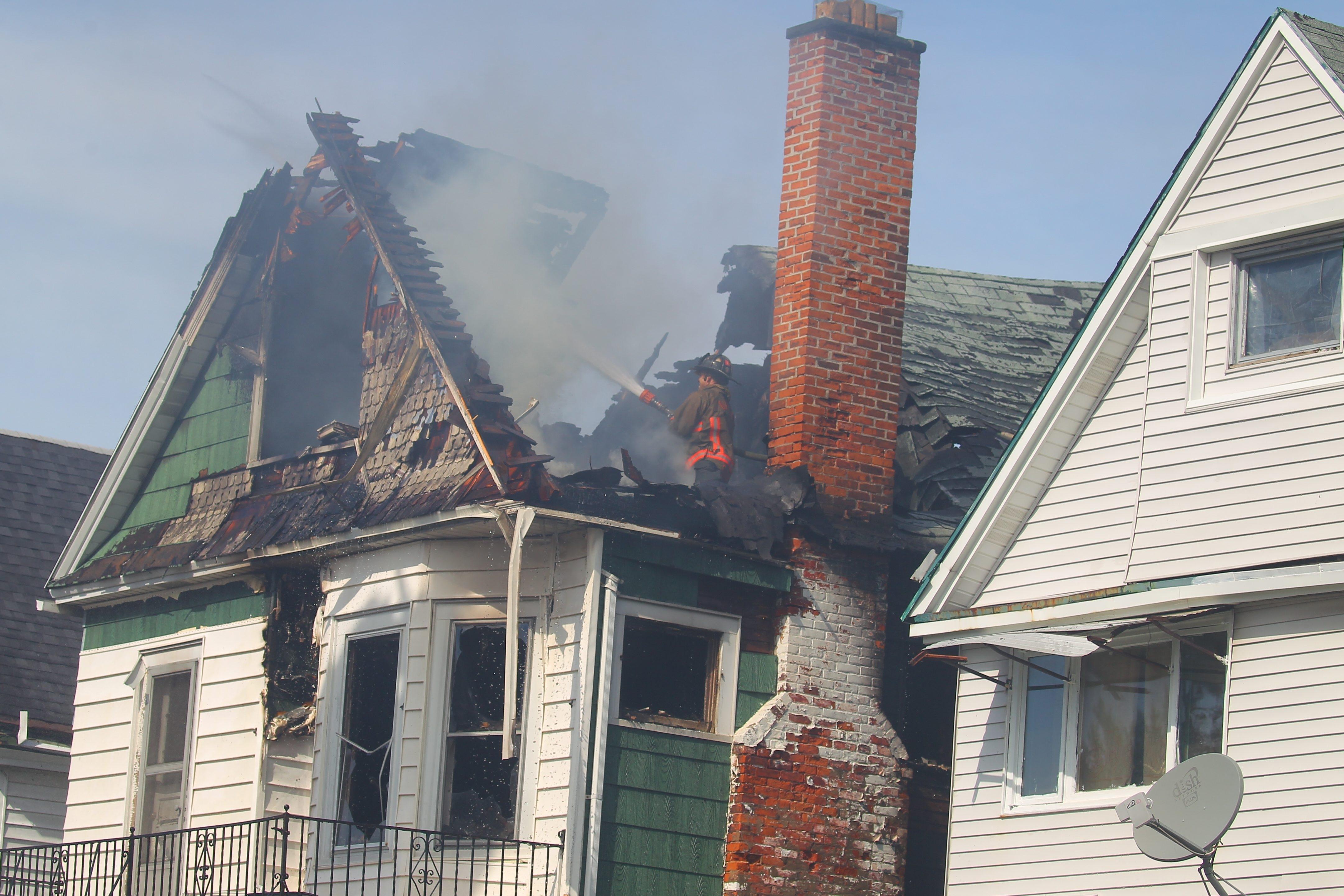 A house fire at 431 14th St. in Buffalo on Sept. 20. (John Hickey/Buffalo News)