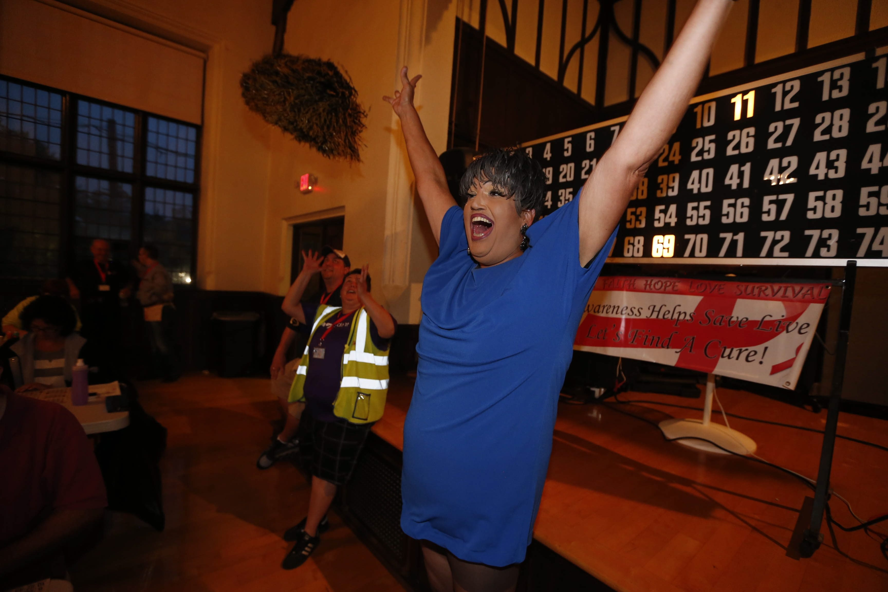"""""""I love entertaining. It's my persona. I like making people laugh and have a good time."""" – Emcee drag queen Gladys Over tells jokes and keeps the party going during Gay Bingo Night at Westminster Presbyterian Church."""