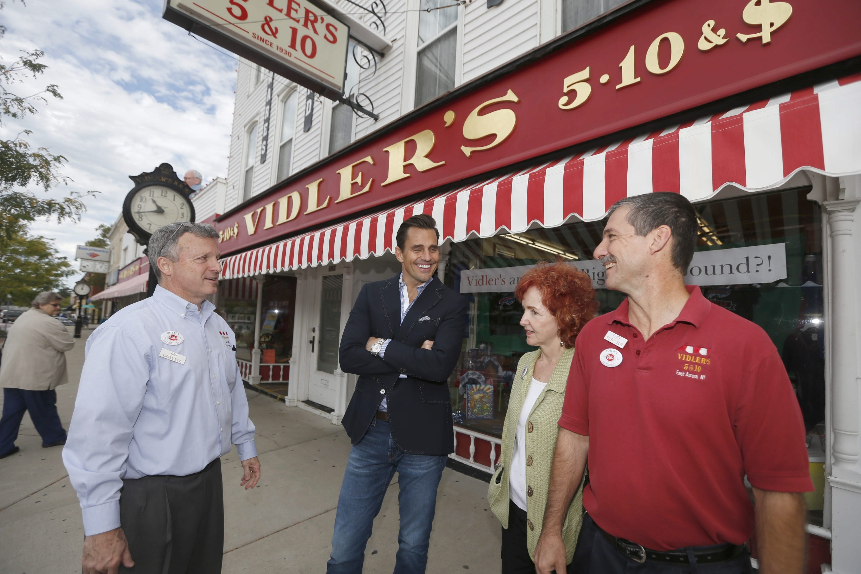 From left, Don Vidler, QuickBooks spokesman Bill Rancic, Beverly Vidler and Cliff DeFlyer outside the iconic store Monday.