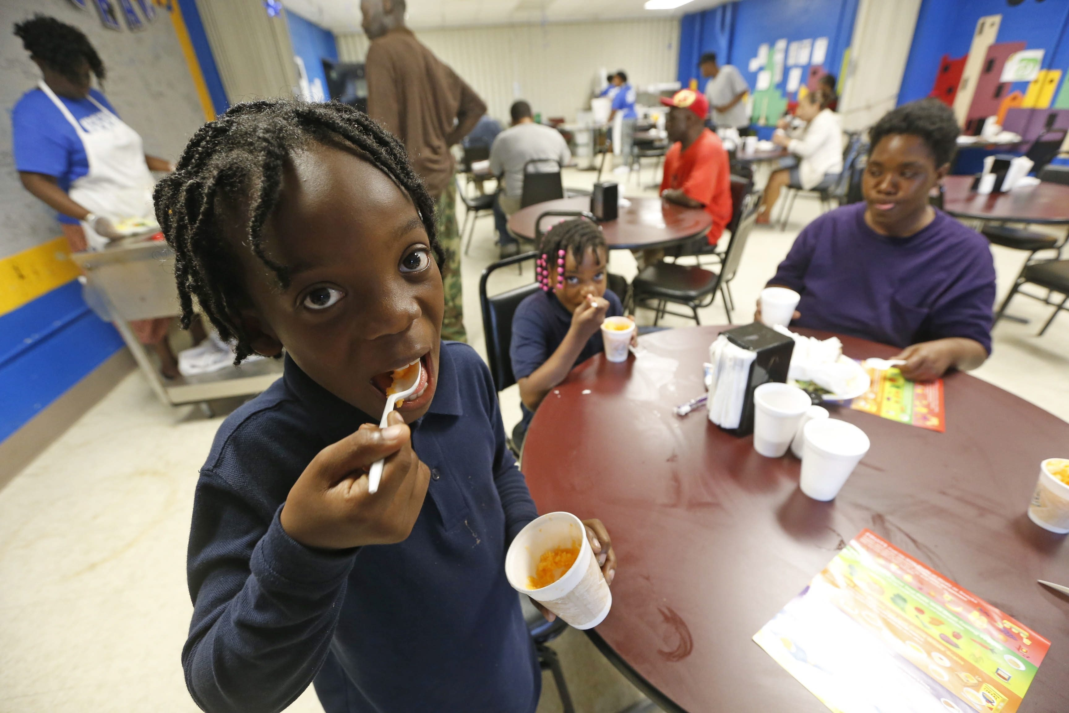 Keisha Chaney and her children Antoine Chaney, foreground, and Speshelle Ponzo, have a meal at the Lt. Col. Matt Urban Hope Center on the East Side, one of the human service agencies that helps the city cope with child poverty.