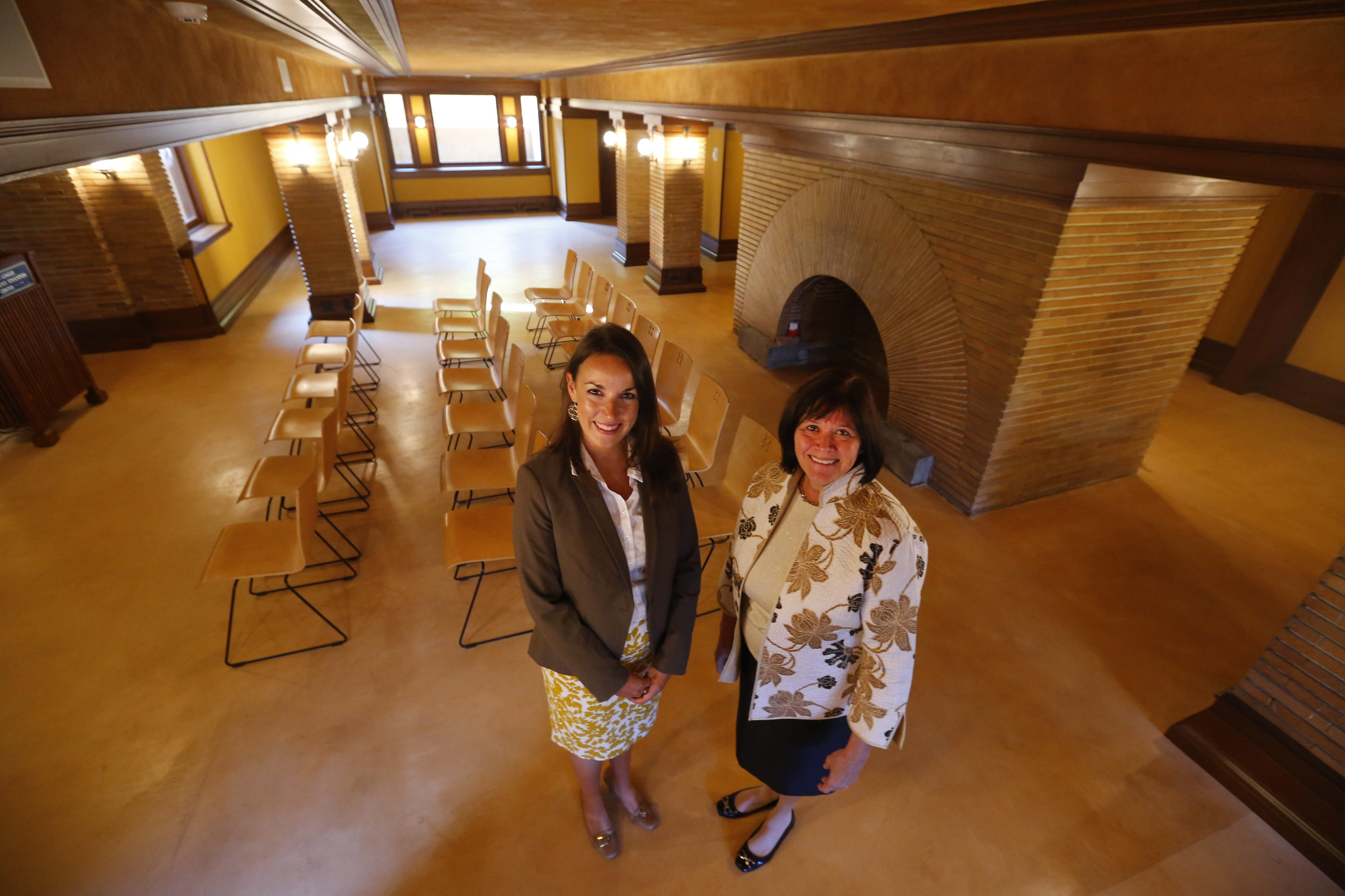 Gina M. Neureuther, director of education and programs at the Darwin D. Martin House, and Mary F. Roberts, executive director of Martin House Restoration Corp., showcase transformed basement now known as Junior League/Buffalo News Education Center.