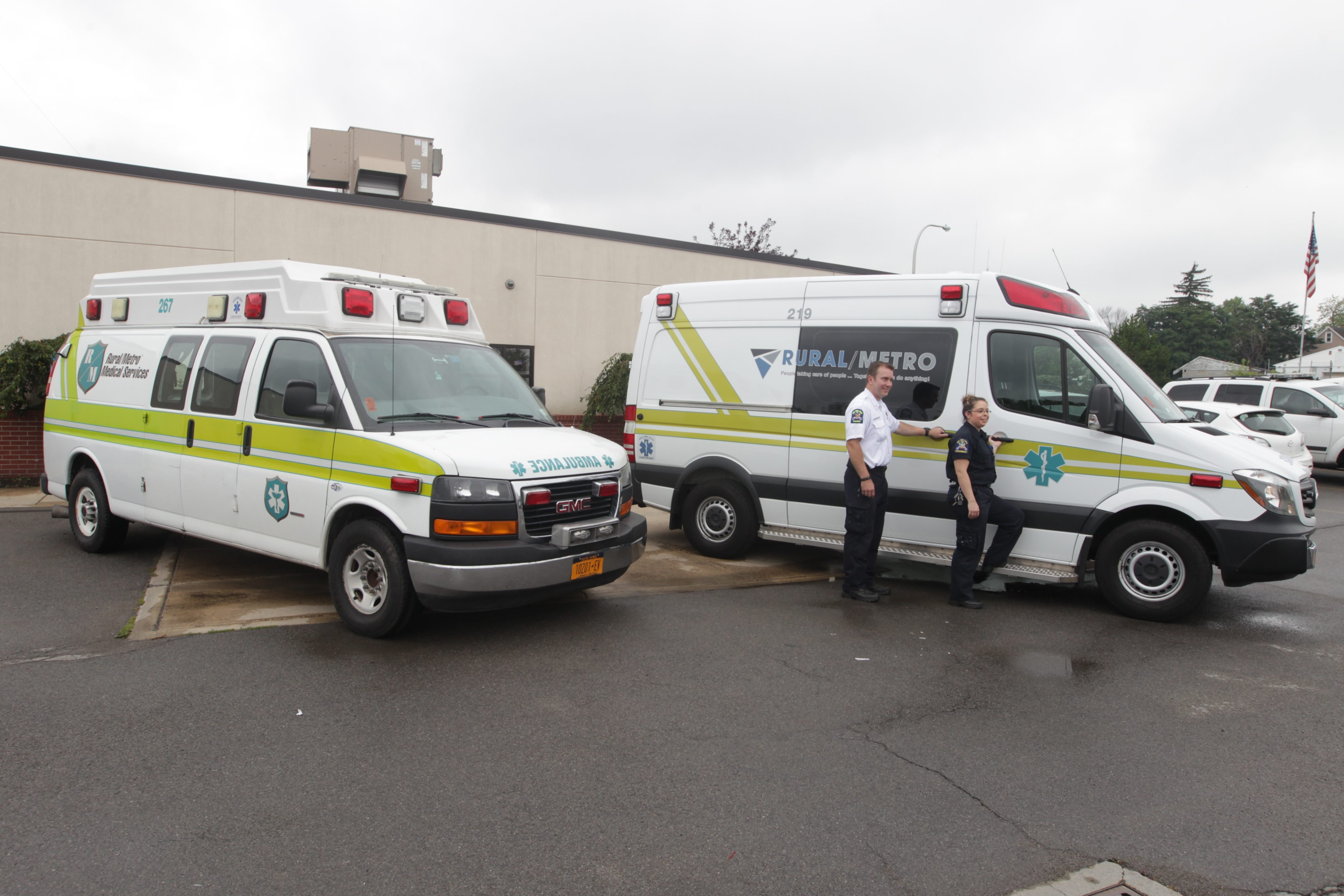 Two Rural/Metro paramedics pose on Aug. 18 with one of Rural/Metro's new Mercedes Ambulances, right, with the older smaller GMC Van type II on left.