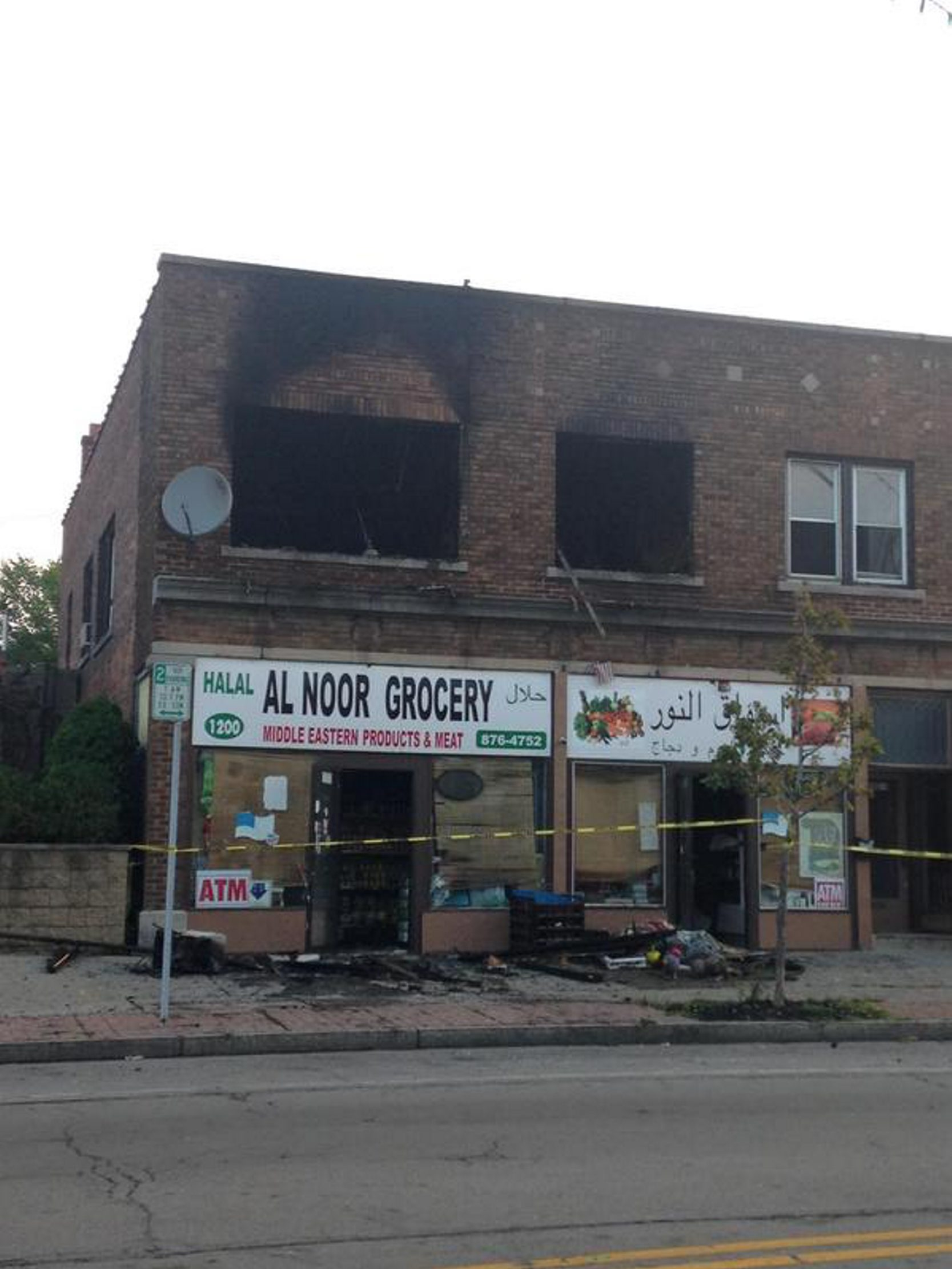 Fire may have begun in air-conditioning unit in apartments over grocery on Hertel. (John Hickey/Buffalo News)