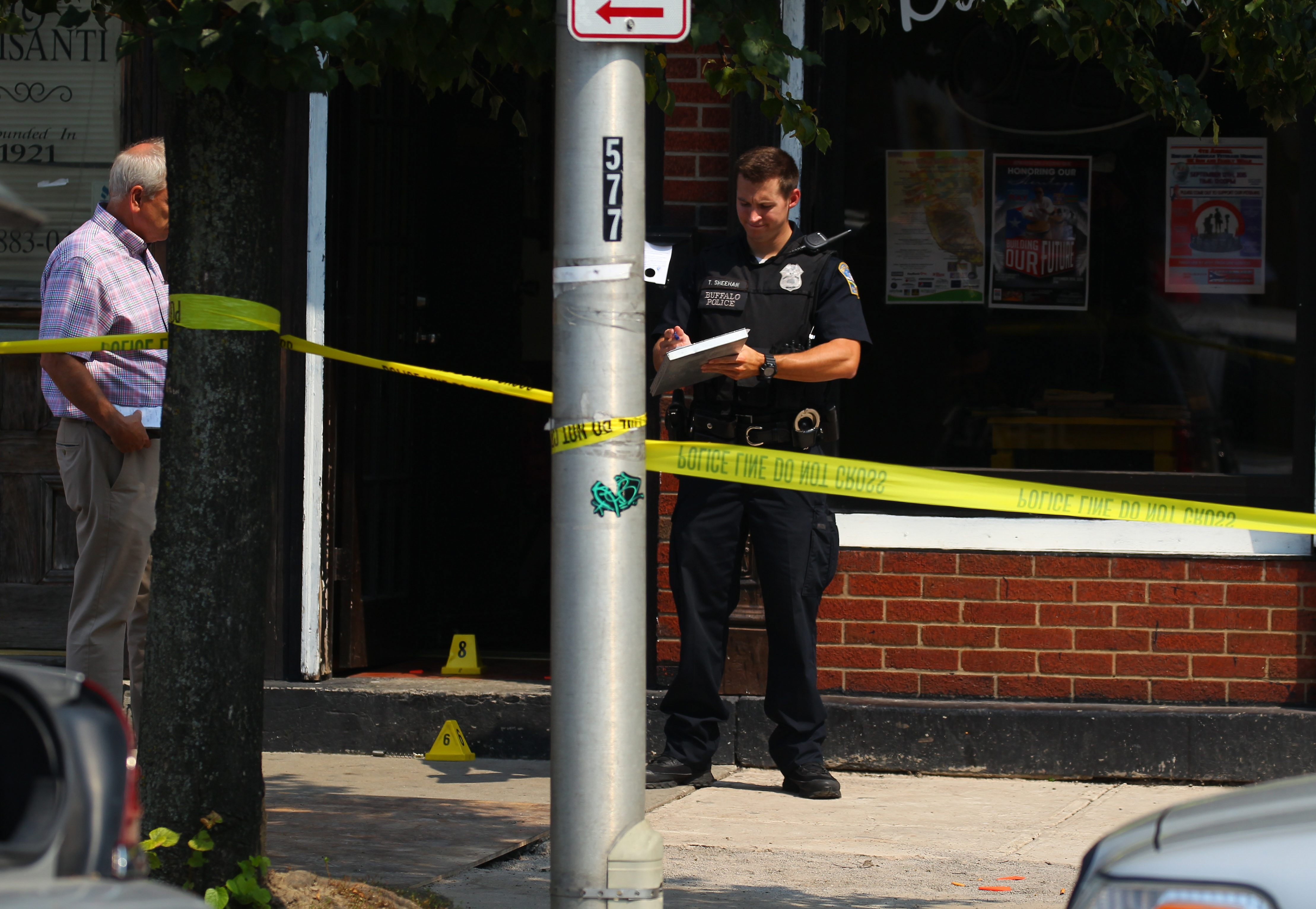 Police investigate outside a barbershop on Niagara Street where Juan Ortiz Santiago, 28, was fatally shot Tuesday.