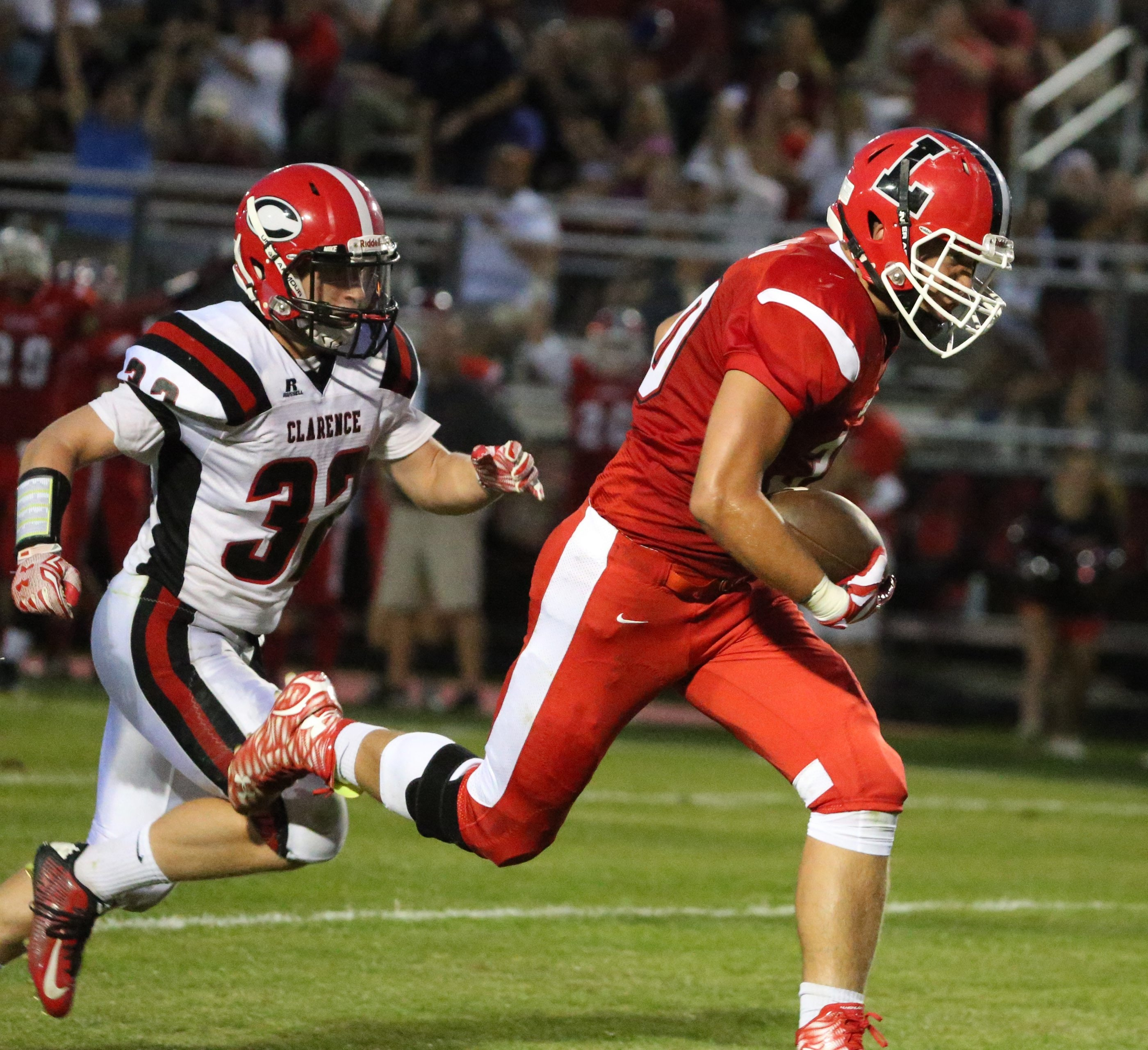 Alex Damiani catches a pass from Lancaster quarterback Dan Speyer in their 55-21 win over Clarence.