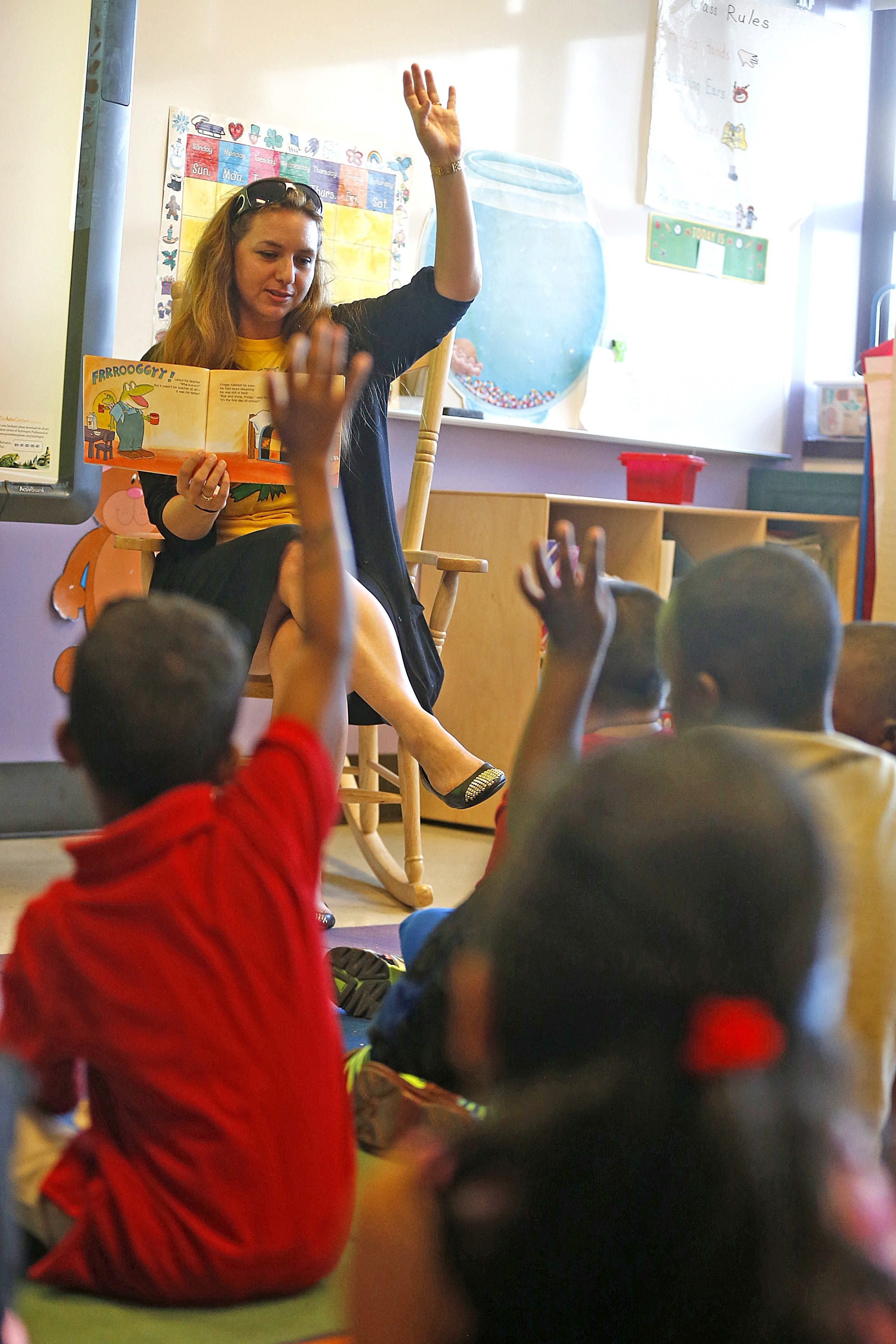 Kindergarten teacher Nicole Nye reads to visiting pupils last week at School 18 in Buffalo. The district is limiting kindergarten class sizes to 20 to 25 students.