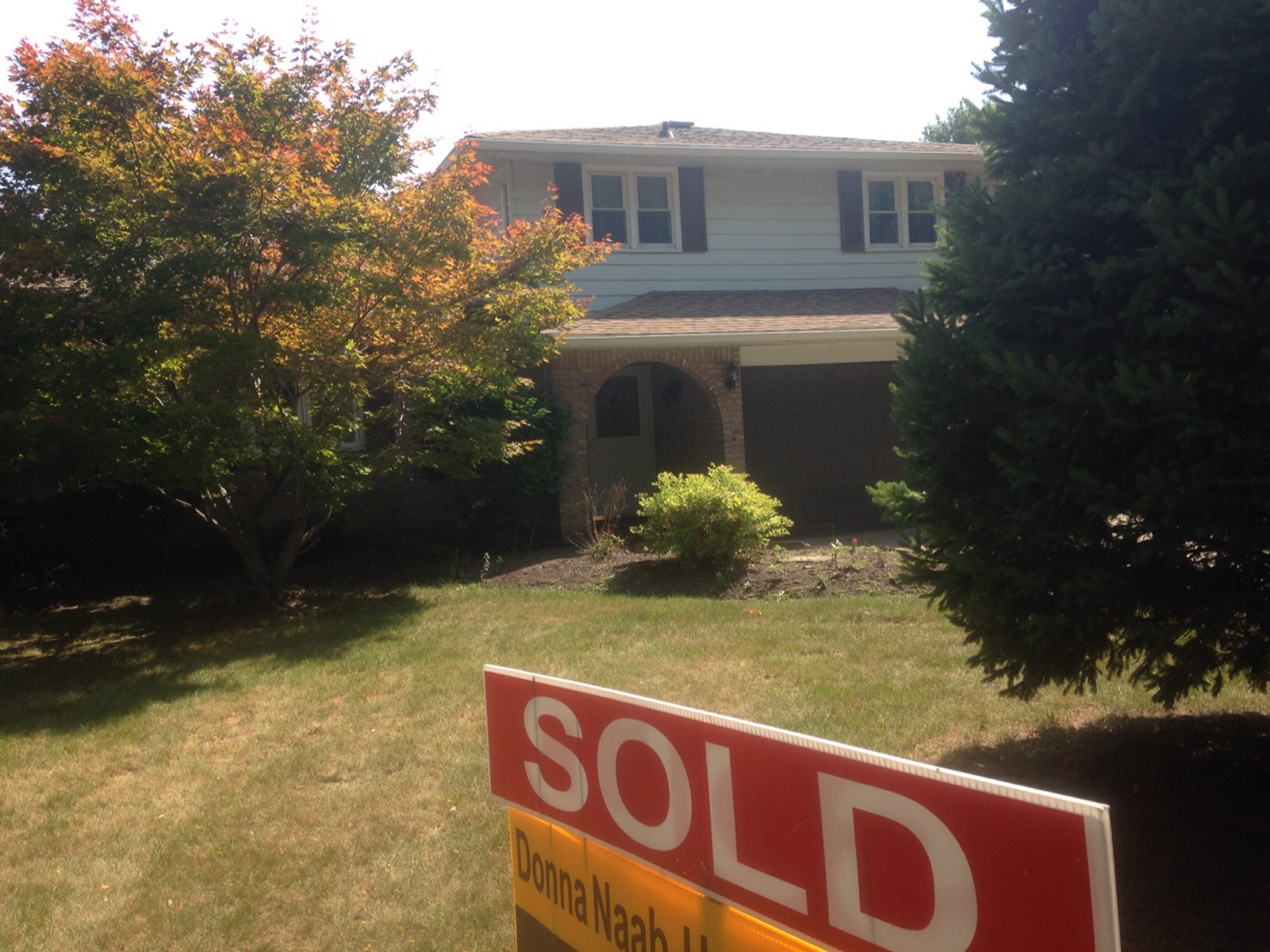 """A """"sold"""" sign in front of a home on Vine Lane in Amherst. (John Hickey/Buffalo News)"""