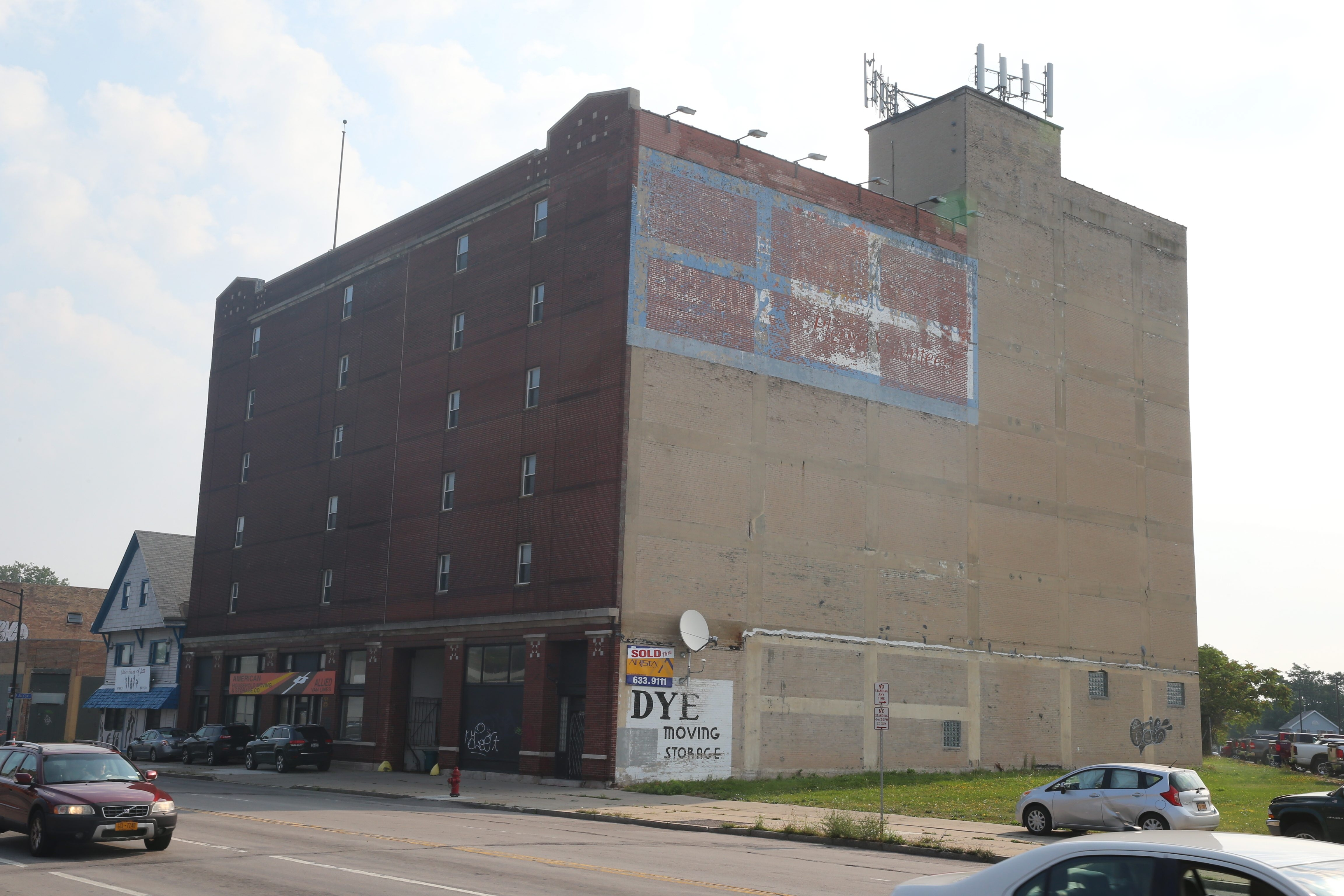 Former American Household Moving & Storage build- ing, 1665 Main St., will become Midtown Apartments.