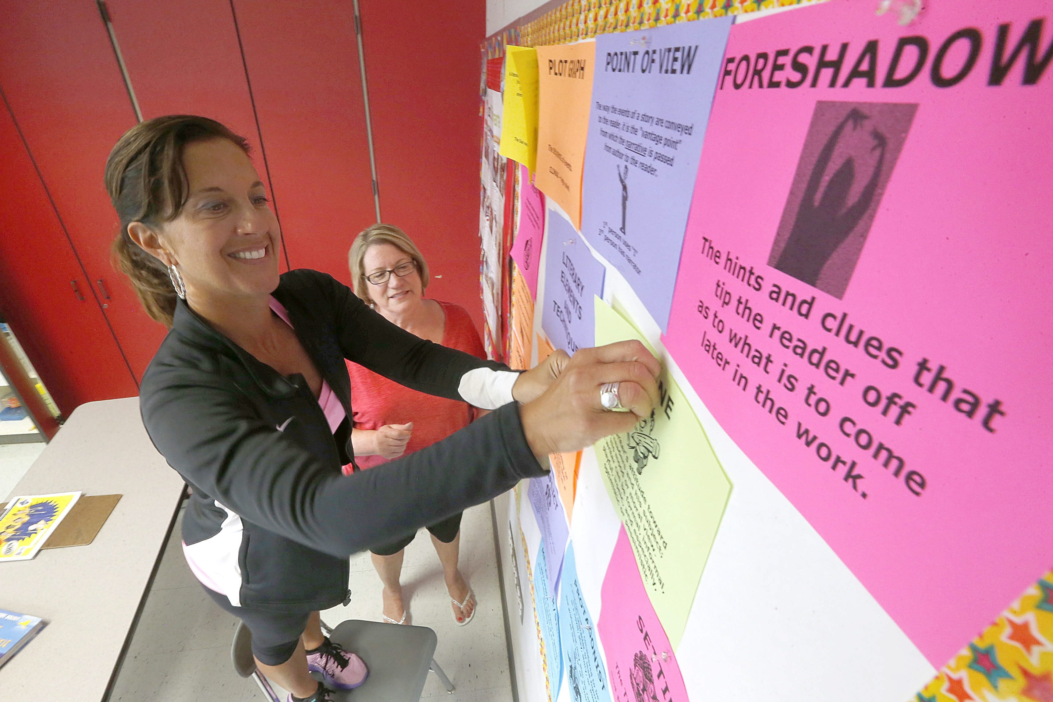 Special-education teachers Maria Mauro, left, and Marian Homiszczak prepare a room for reading classes at Niagara Falls High School, where classes started Wednesday.