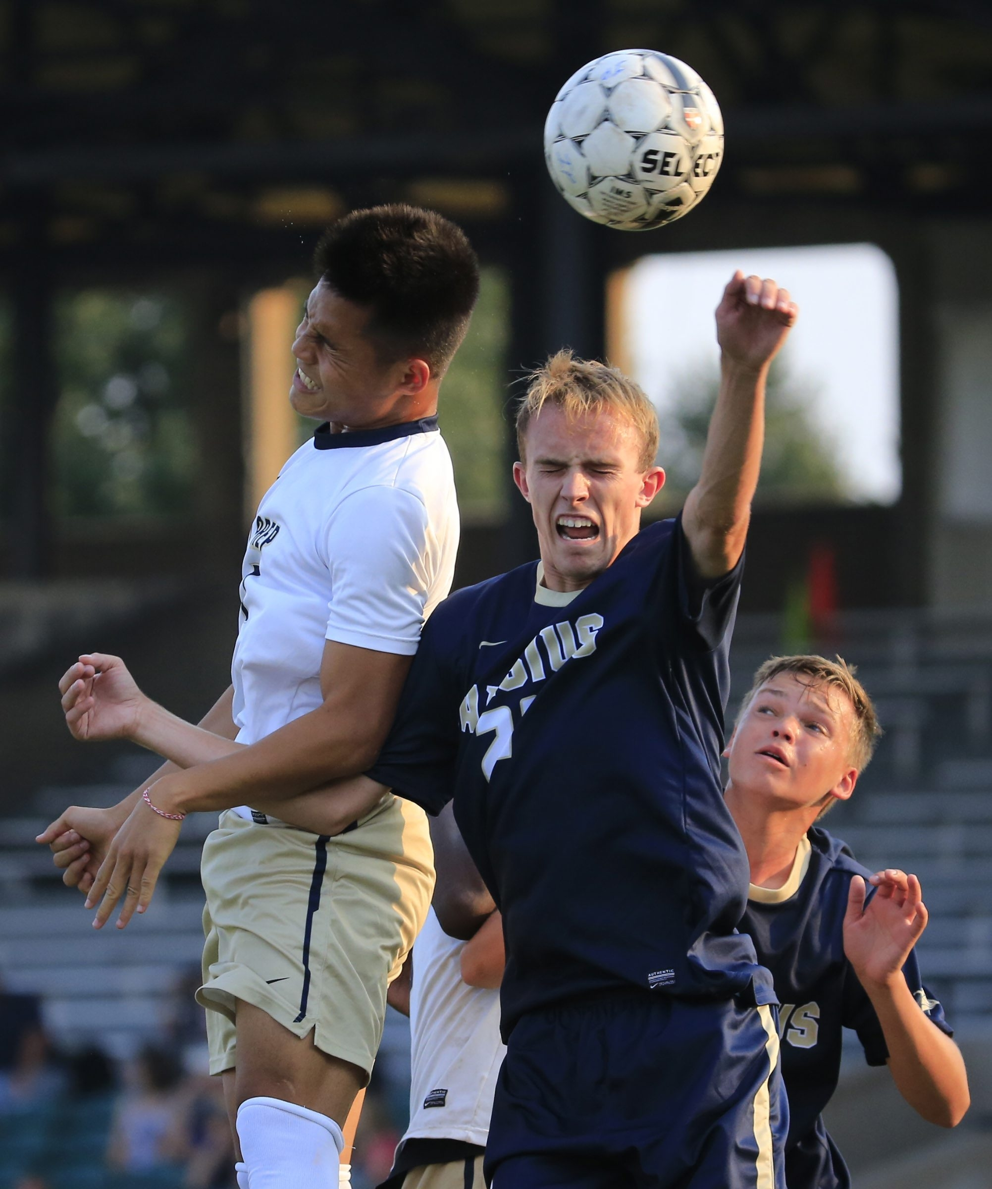 Pa Lu of I-Prep, left, and Joseph Foster of Canisius battle in their nonleague soccer game at All-High Stadium.