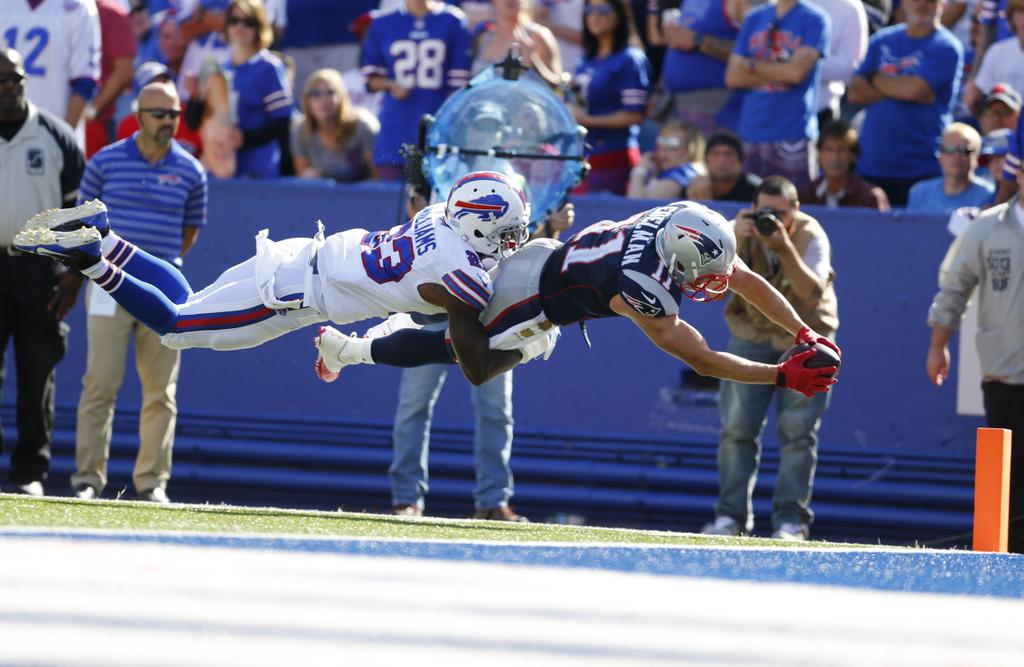 Julian Edelman dives in for his late third-quarter touchdown that put New England up, 34-13. (Mark Mulville/Buffalo News)