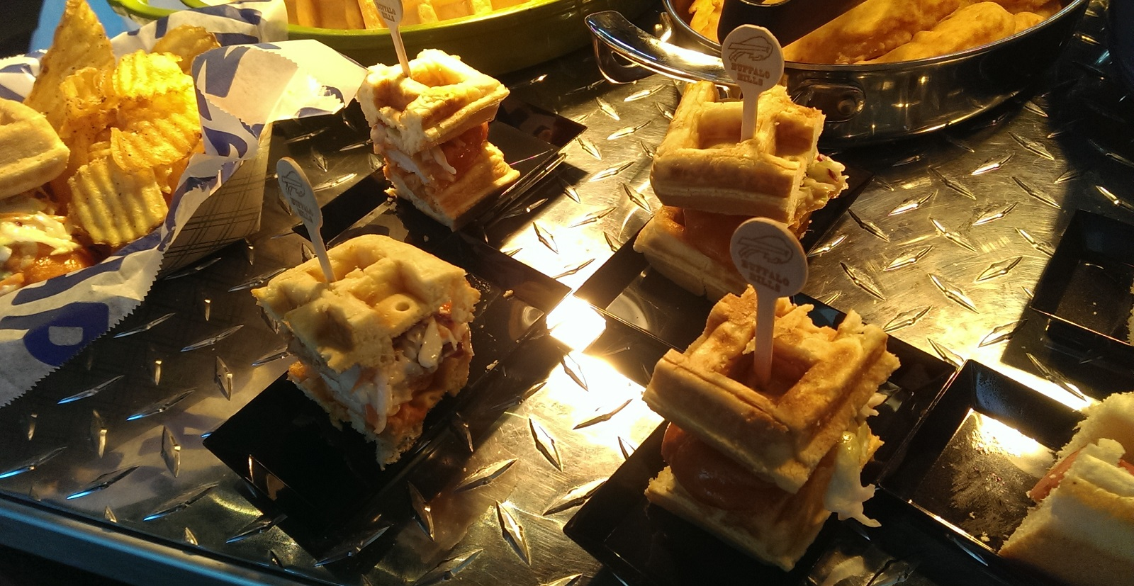 Sample-sized portions of Jerry Hughes' chicken-and-waffle-the-Quarterback sandwich, new to Bills concessions this fall. (Ryan Nagelhout/Special to The News)